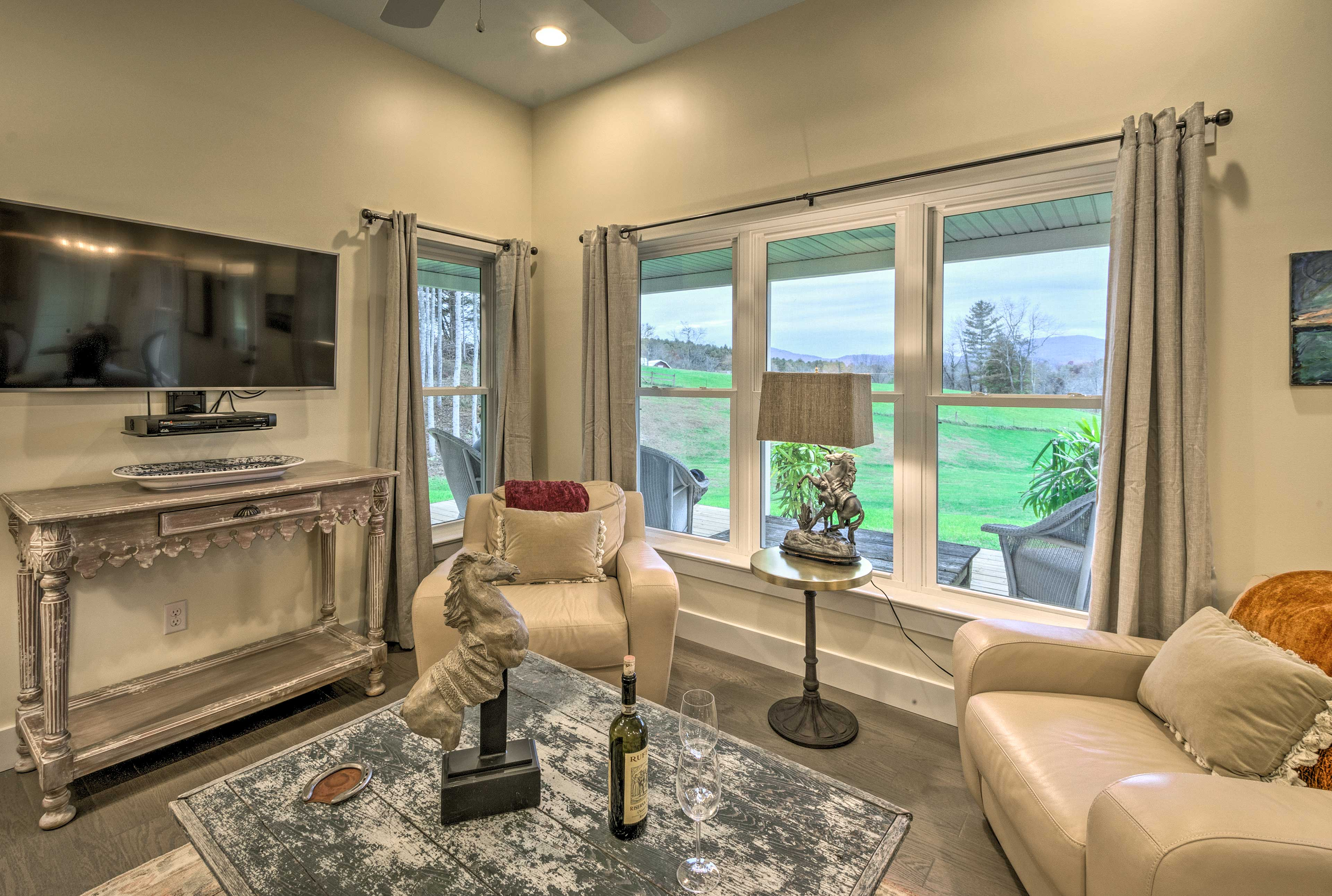 Admire views of vibrant greenery from the living room.
