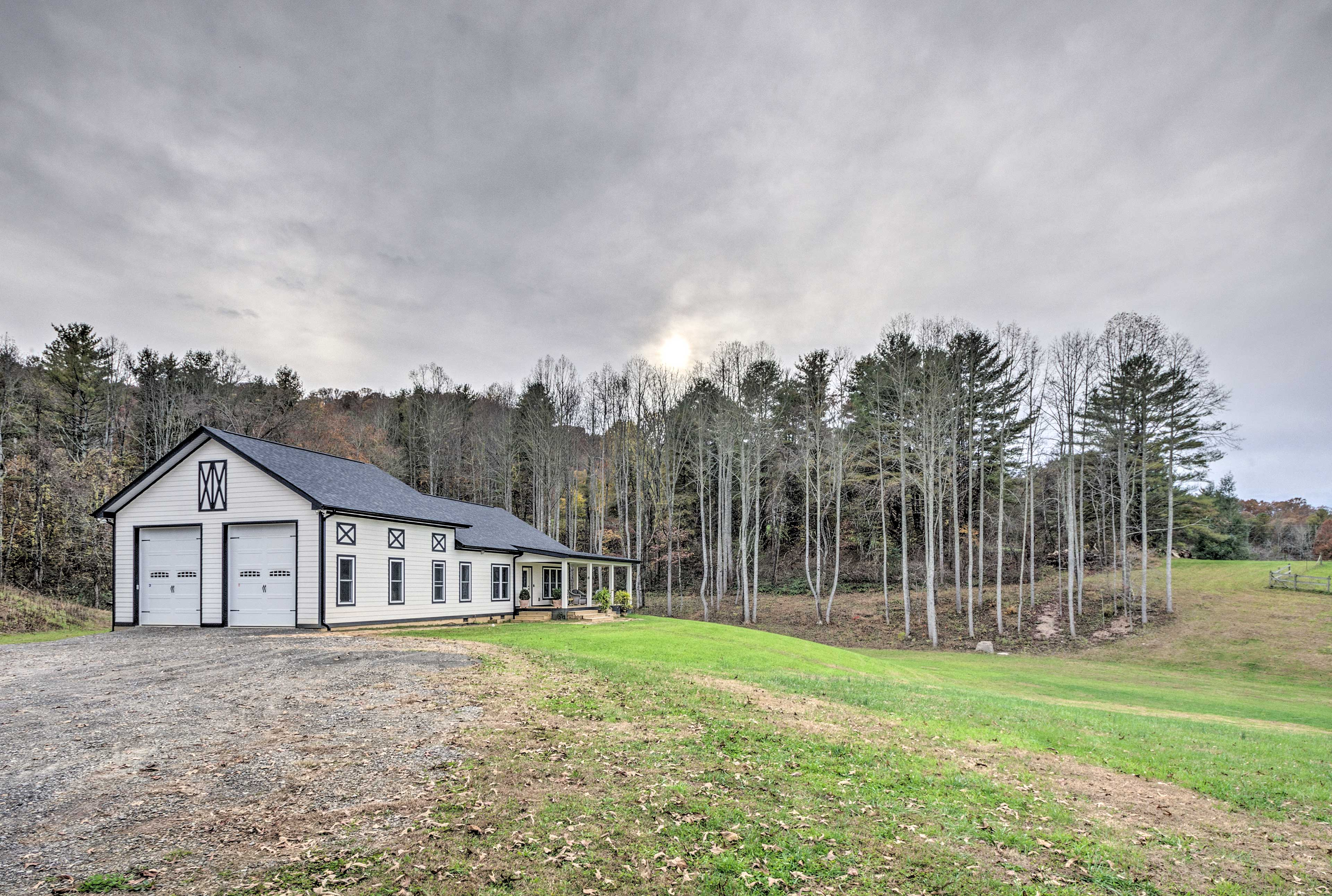 This recently built home is situated on a beautiful 4-acre horse farm!
