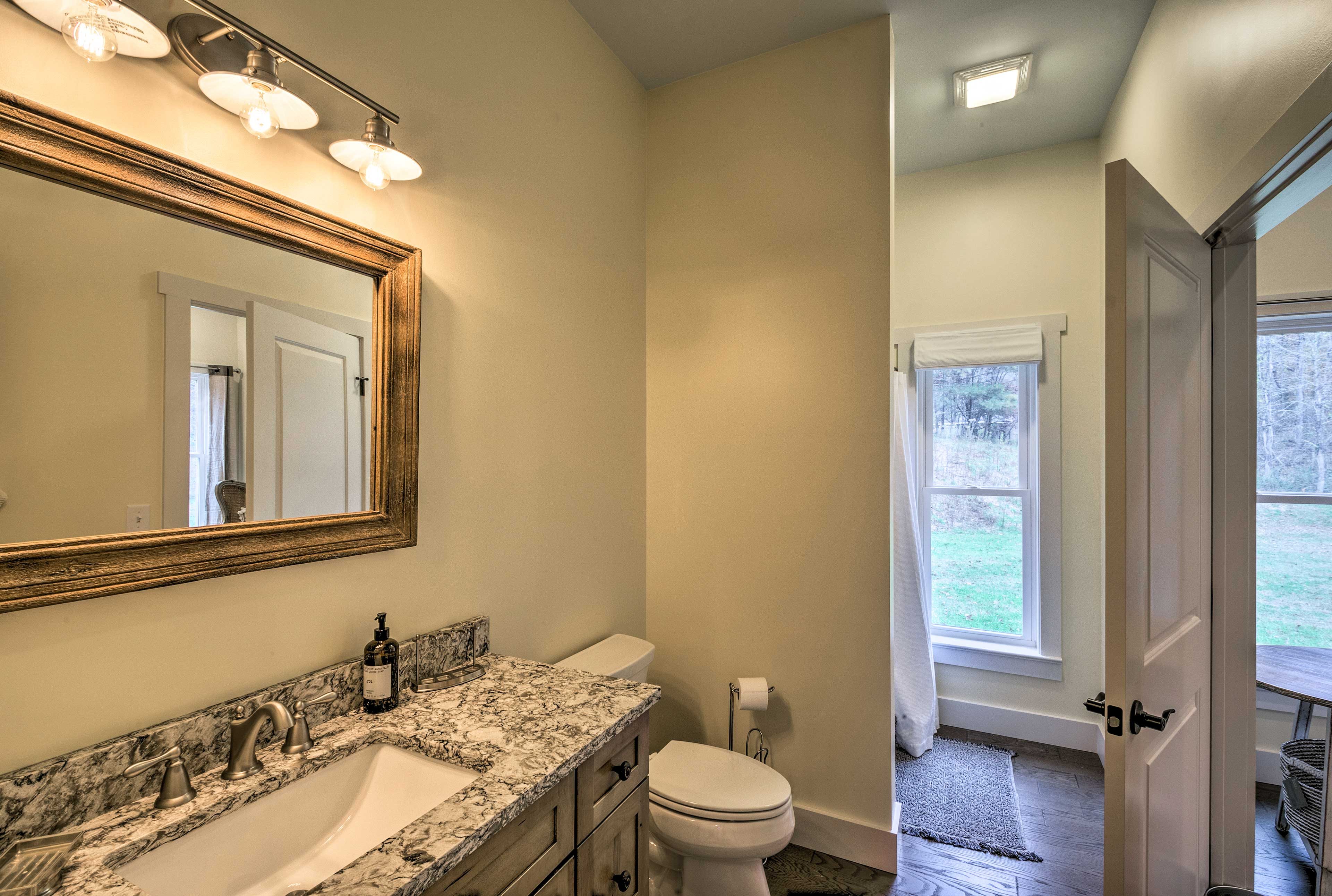 Freshen up in one of 2 bathrooms in the home.