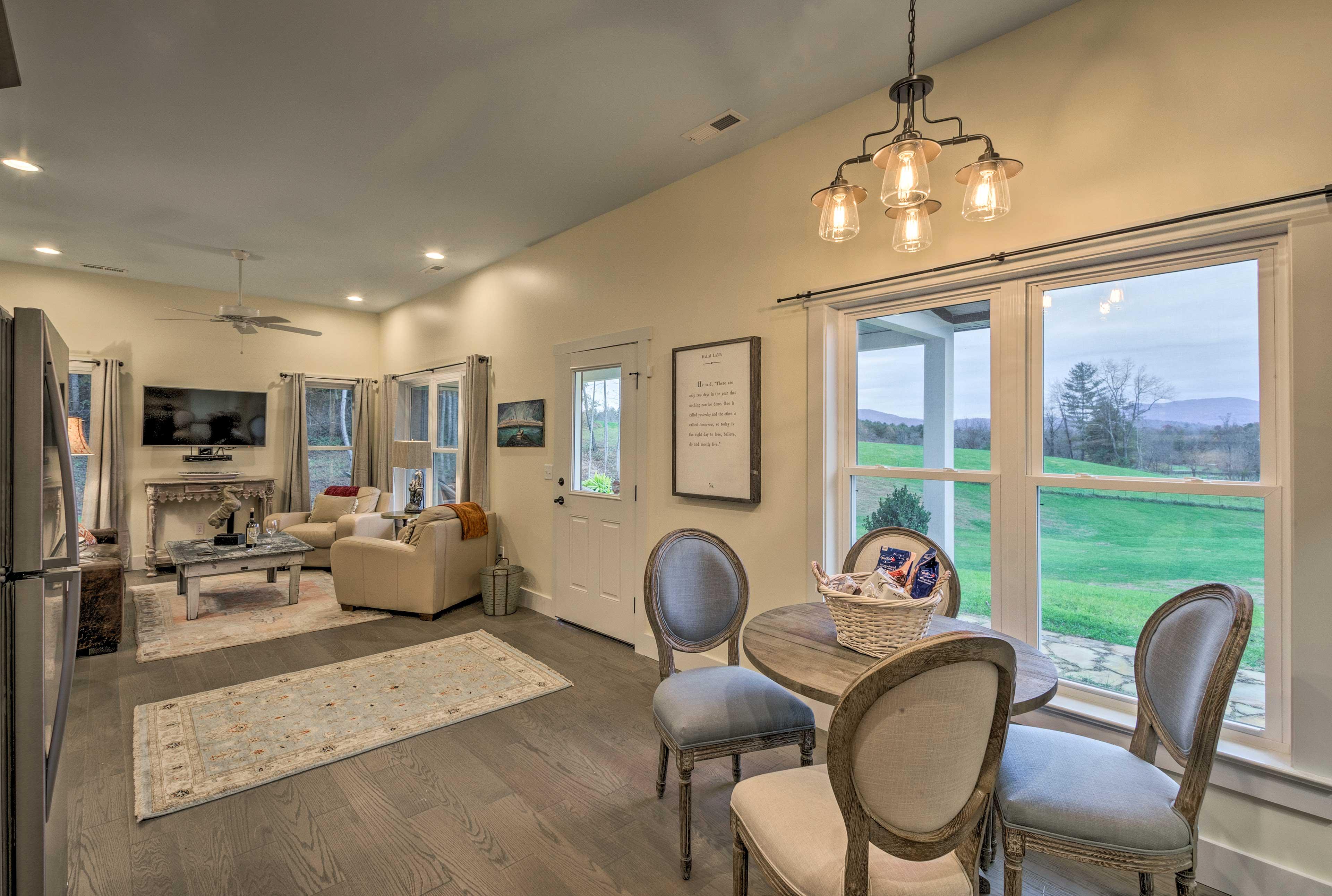 Natural light illuminates the home through a wealth of windows.