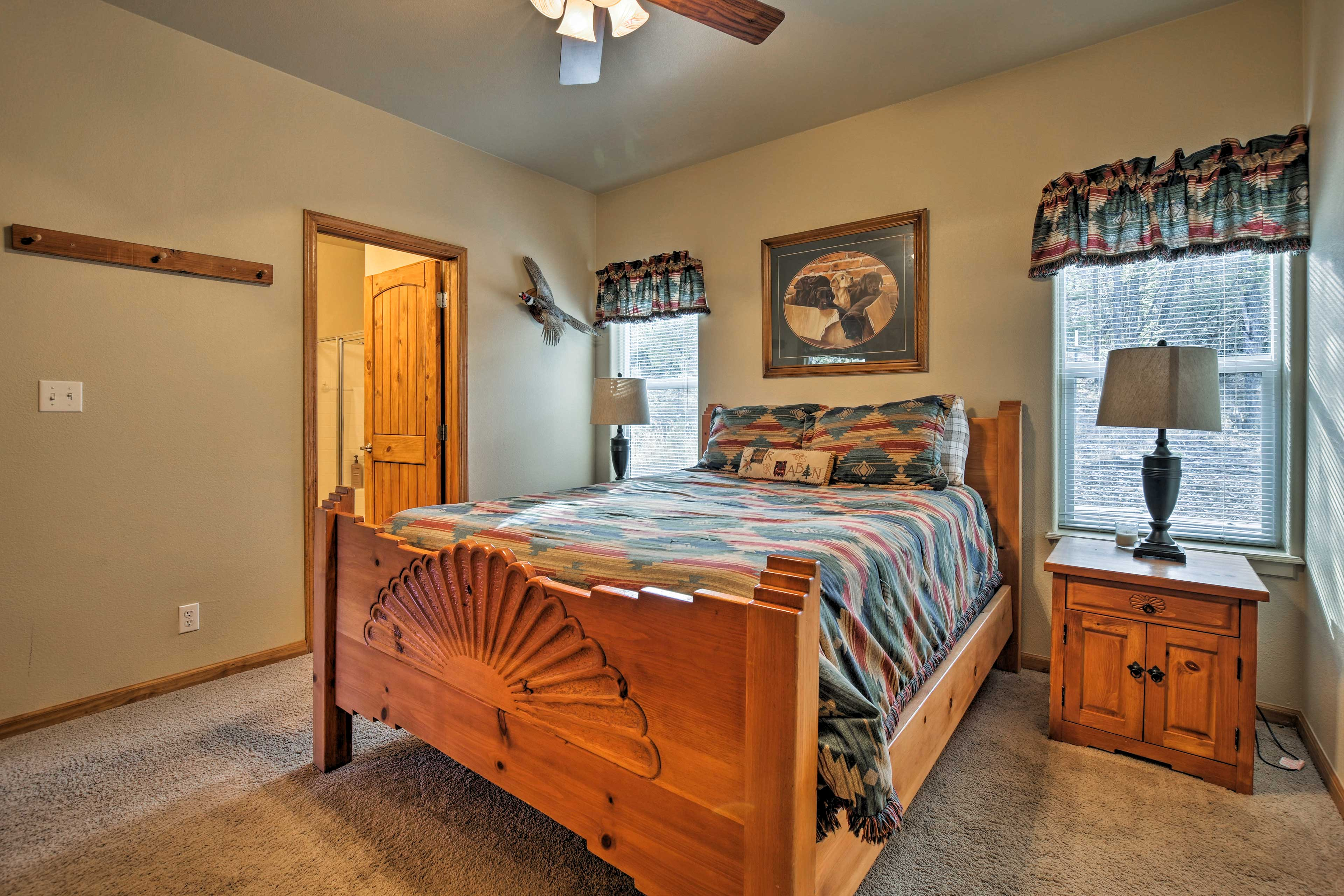 The master features a queen bed and an en-suite bath.