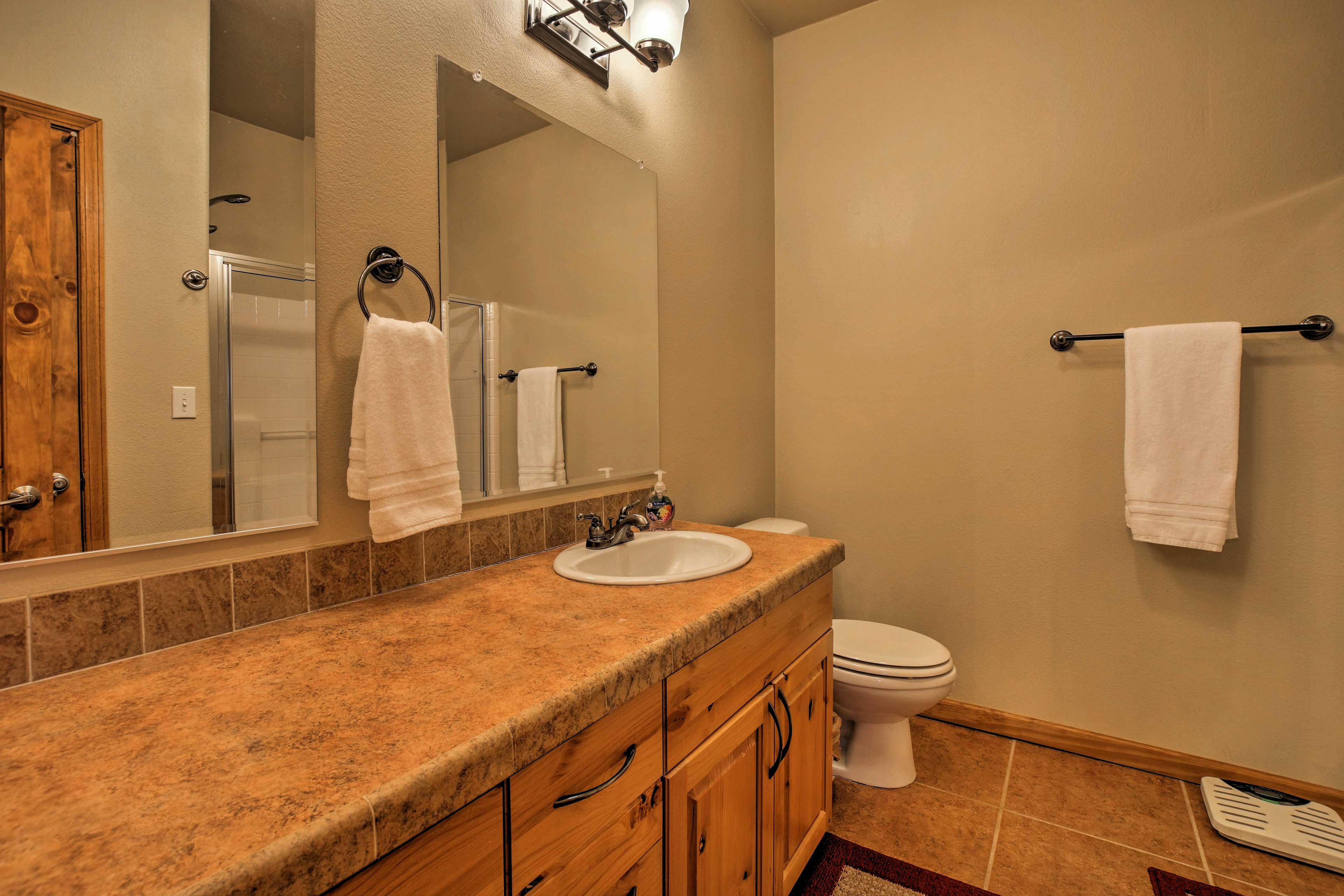 The bathroom is equipped with a walk-in shower.
