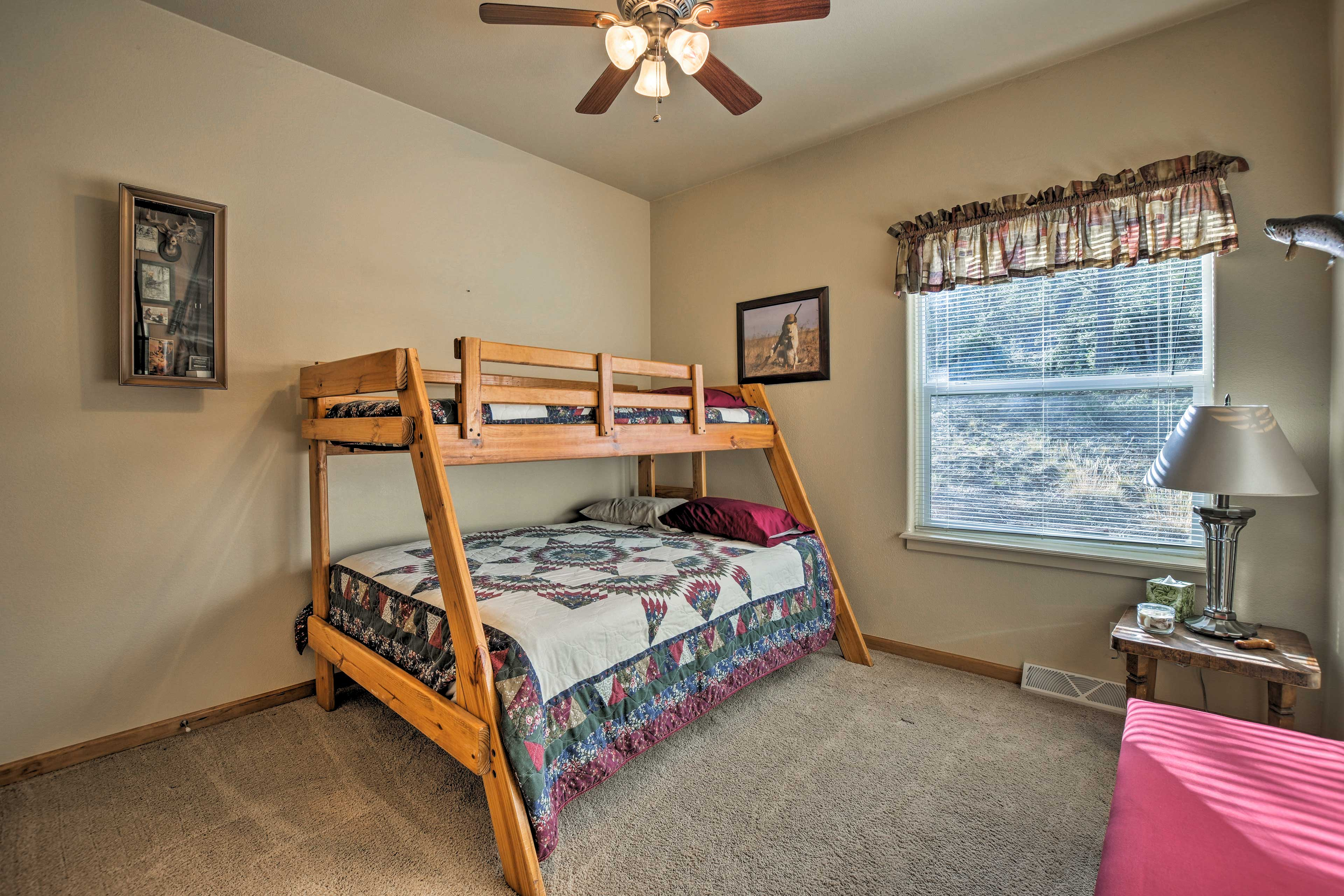 Two guest bedrooms include twin-over-full bunk beds.