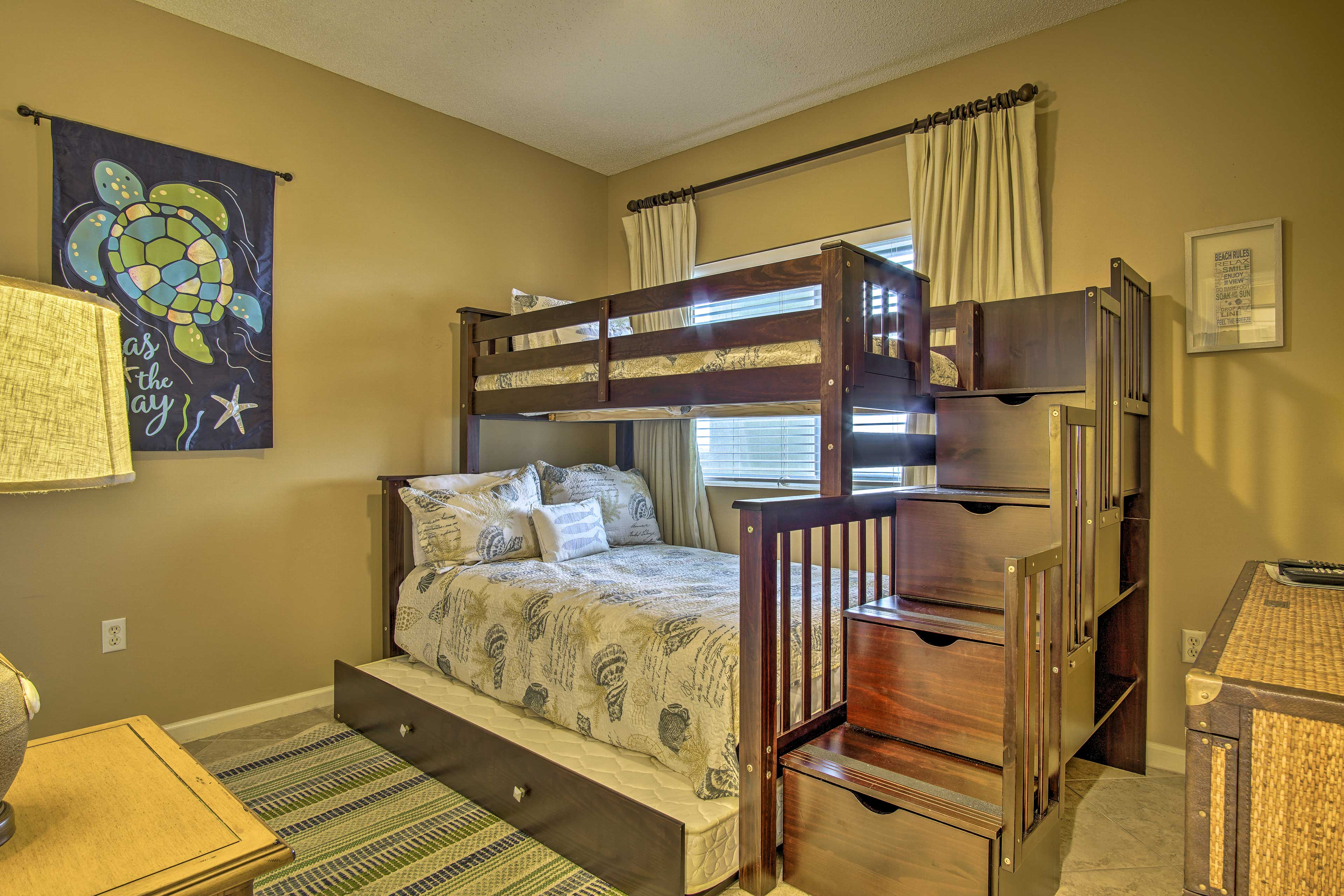 This room boasts a twin-over-full bunk bed with twin trundle bed.