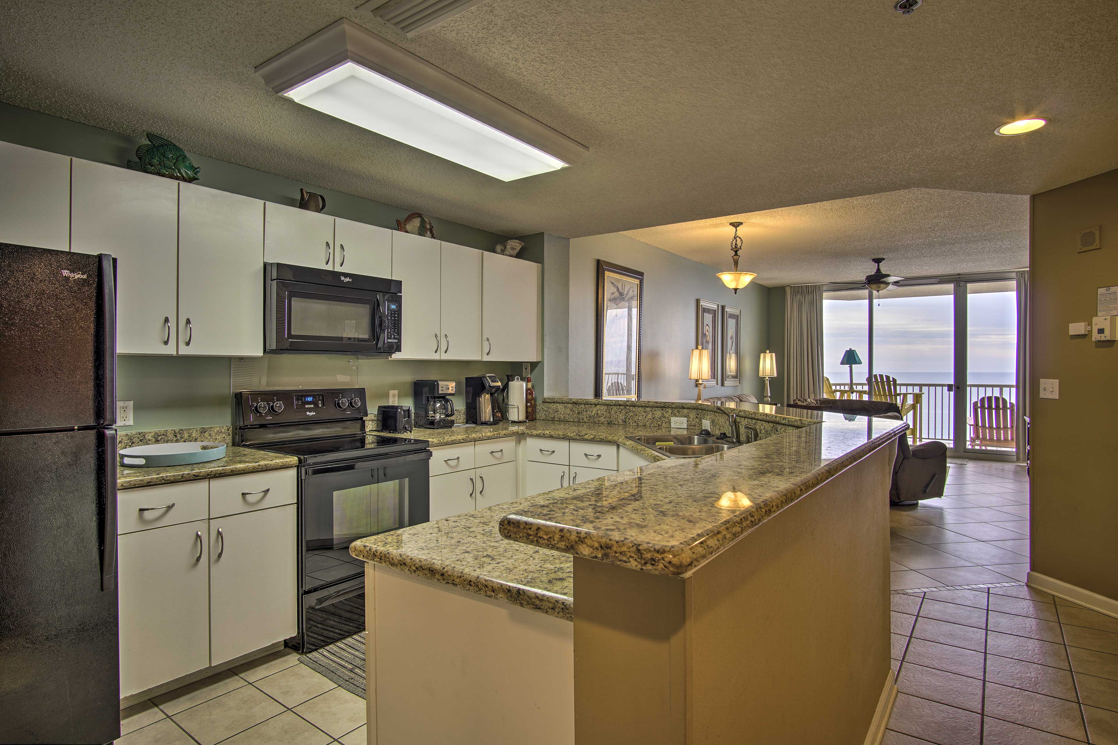 Granite countertops highlight the fully equipped kitchen.