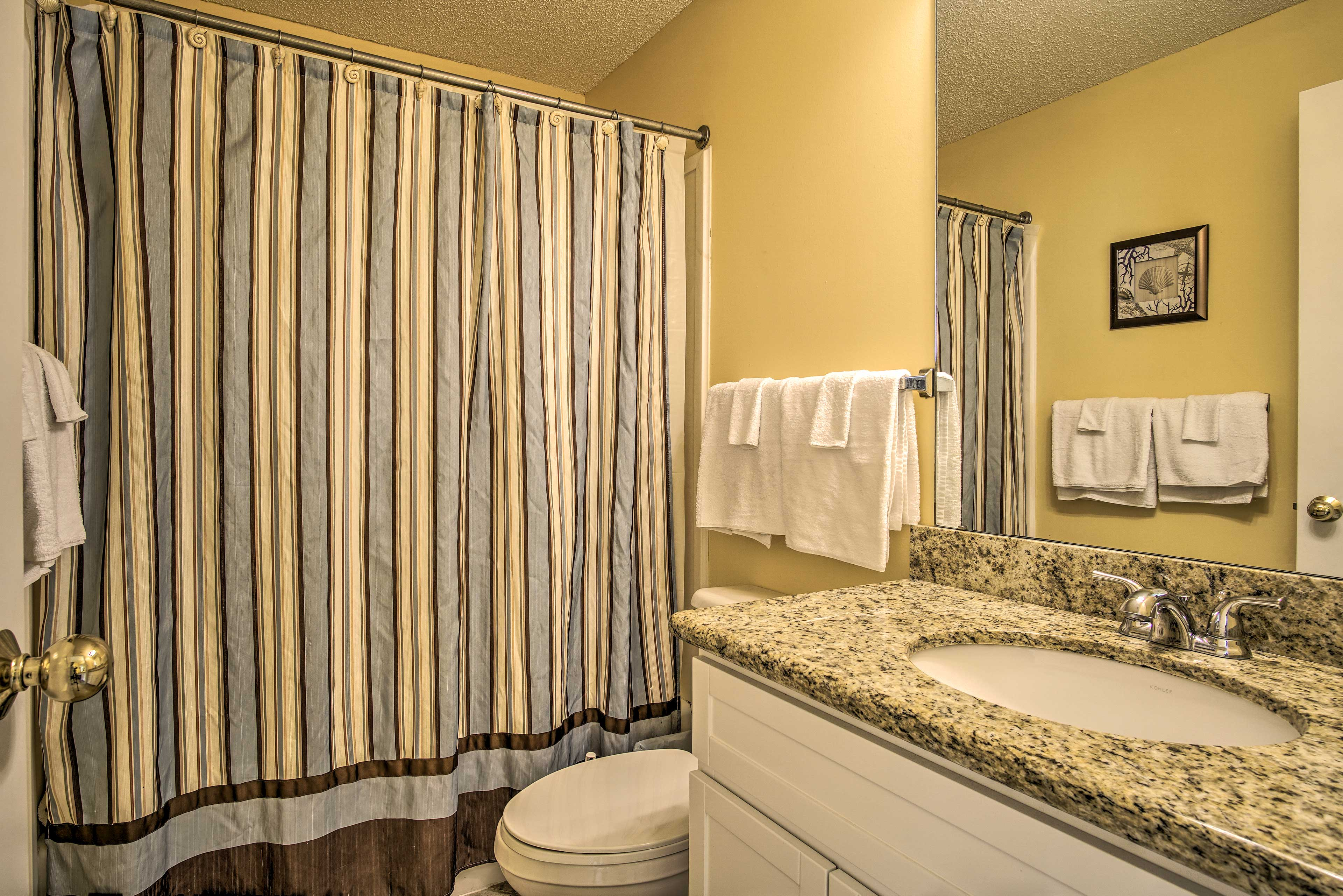 Rinse off in the shower/tub combo in the master en-suite bathroom.