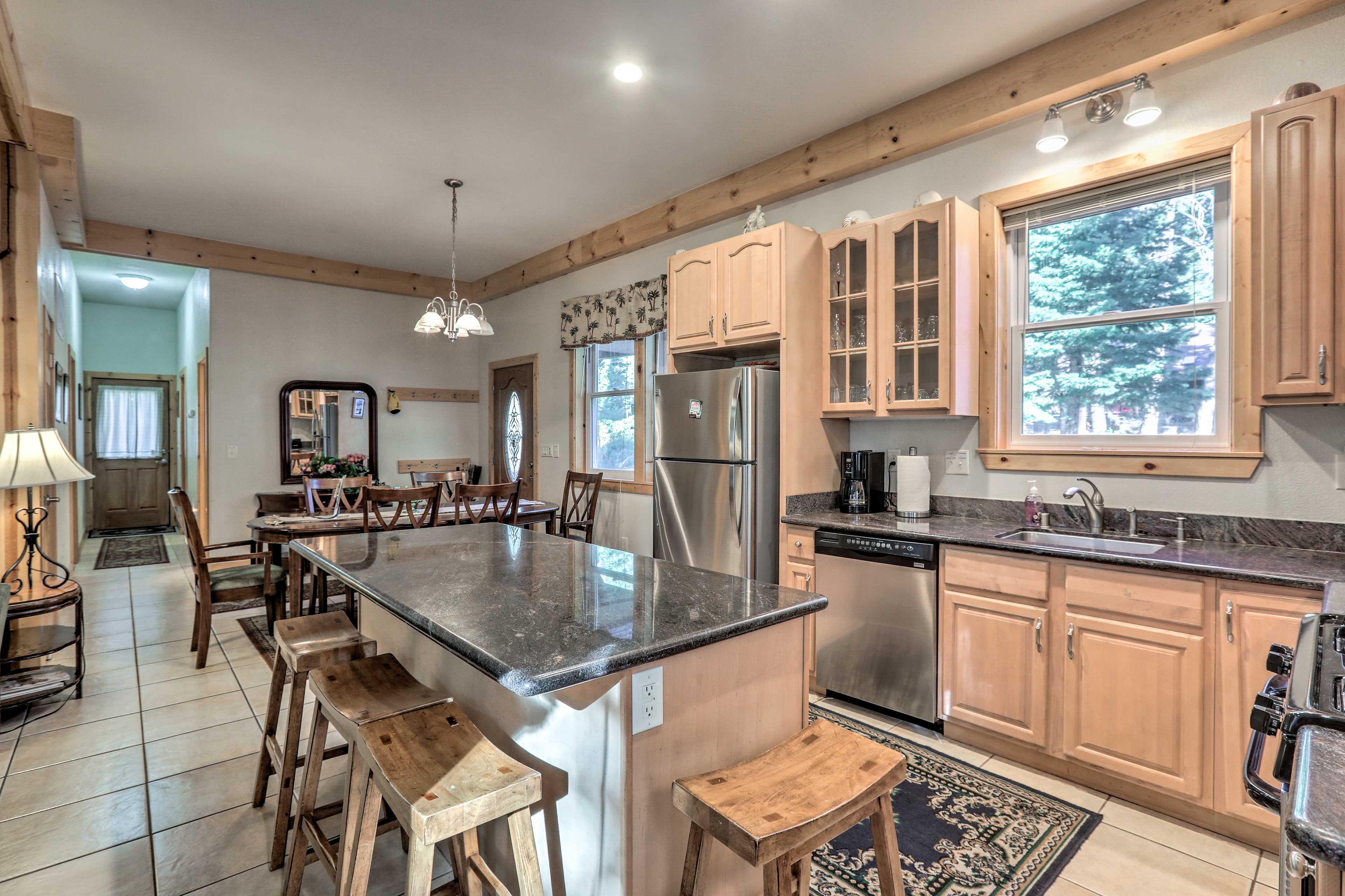 The house has a gourmet kitchen and beautiful wooden accents.