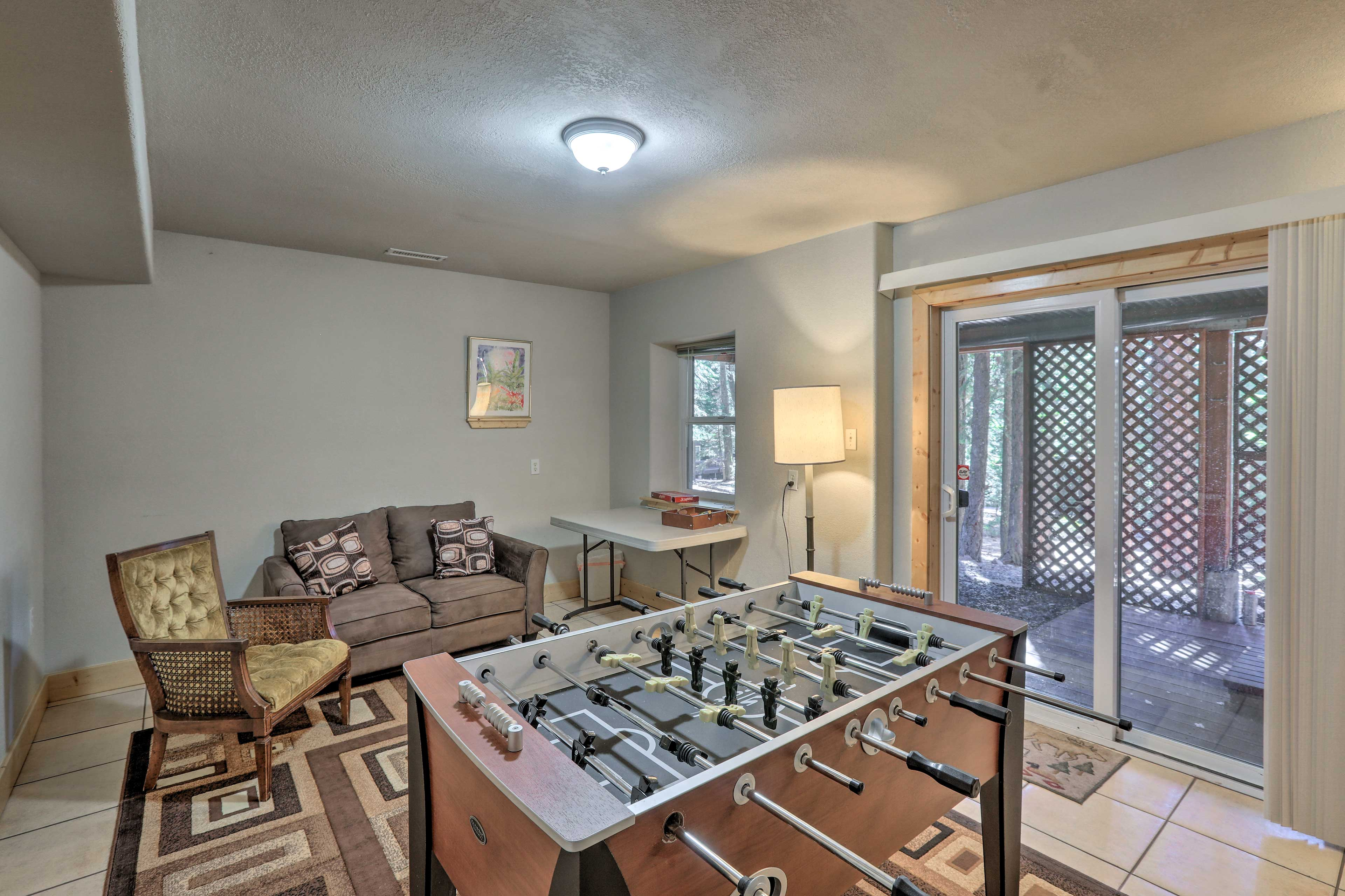 The downstairs game room has a foosball table and access to the hot tub!