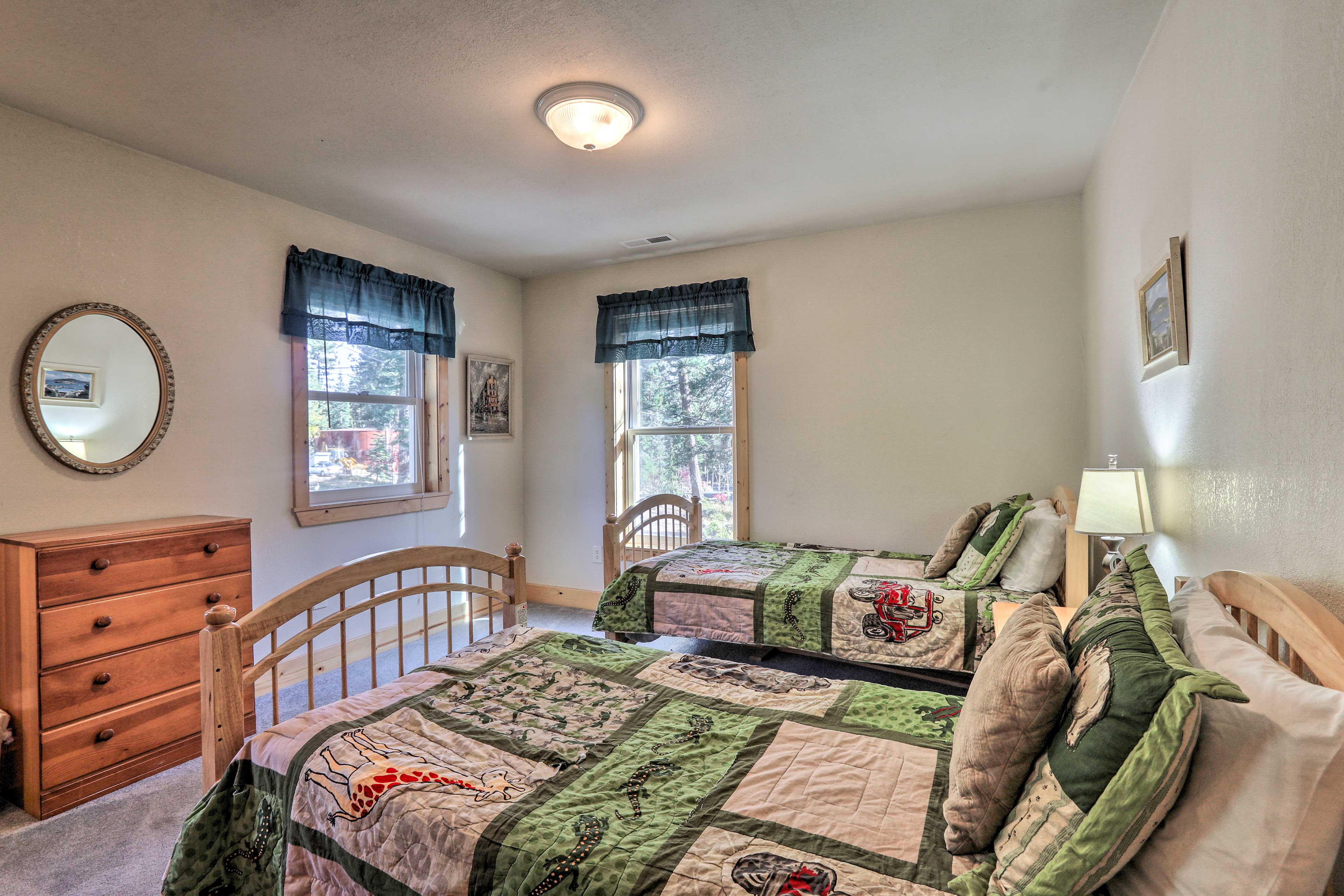 The second bedroom has 2 twin beds and plenty of natural sunlight.