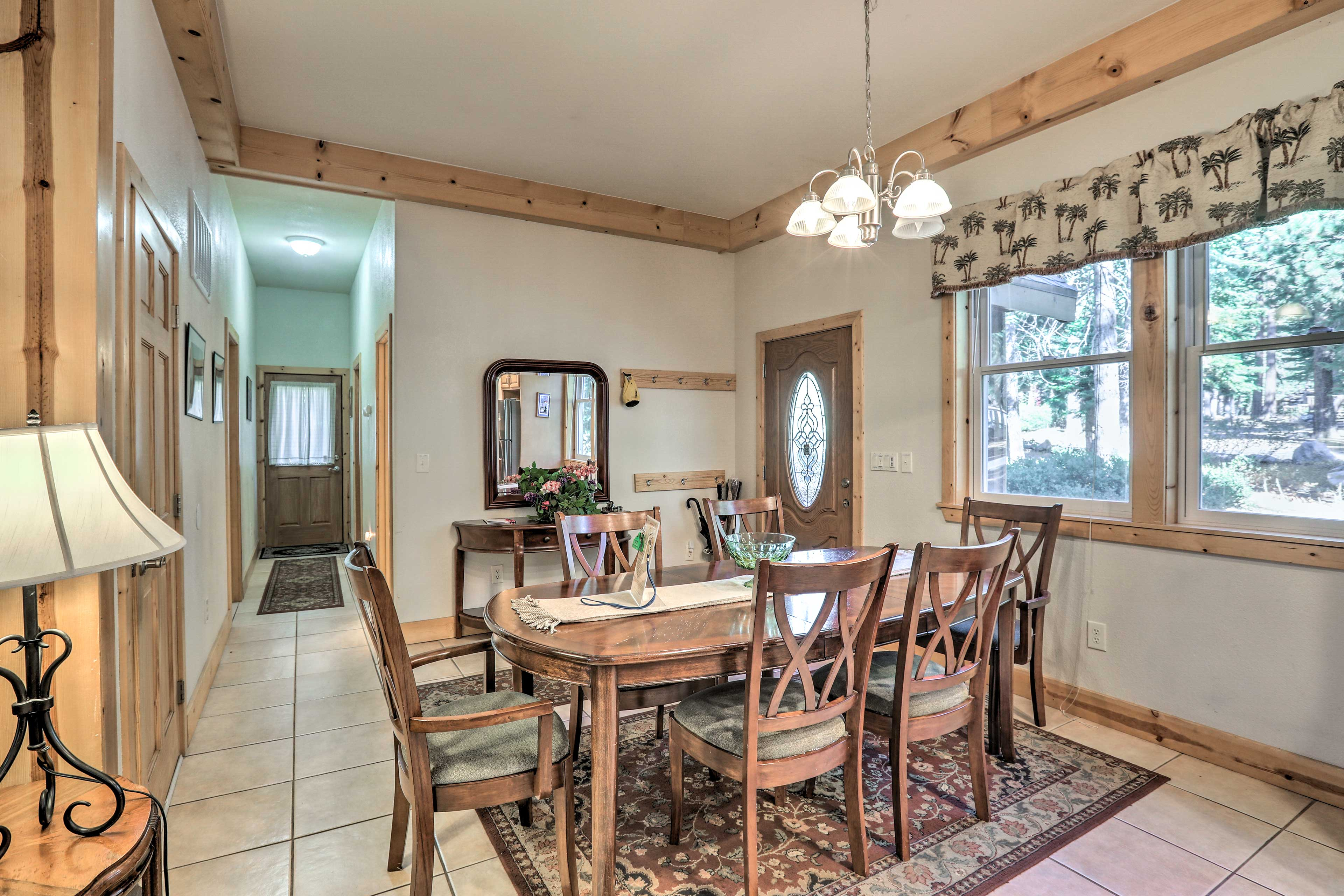 Make memories at the 6-person dining table adjacent to the kitchen.