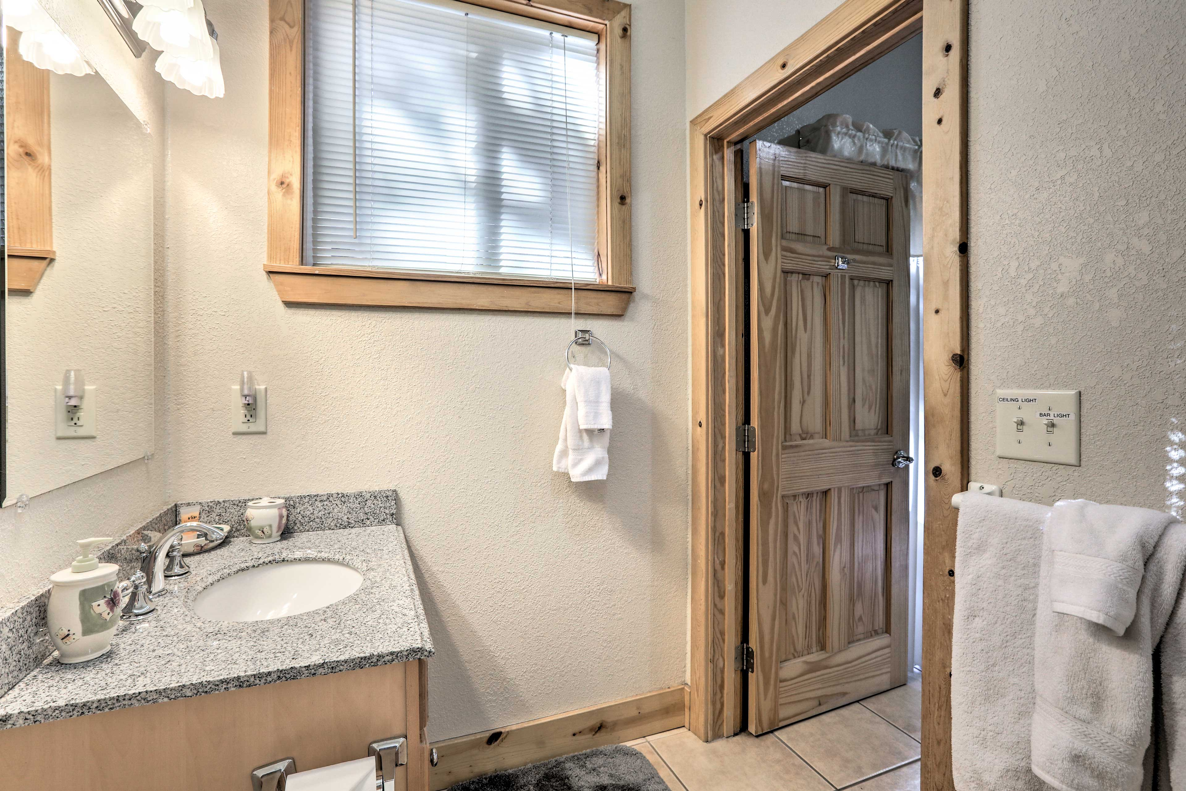 Rinse off after a day on the slopes in this third full bathroom.