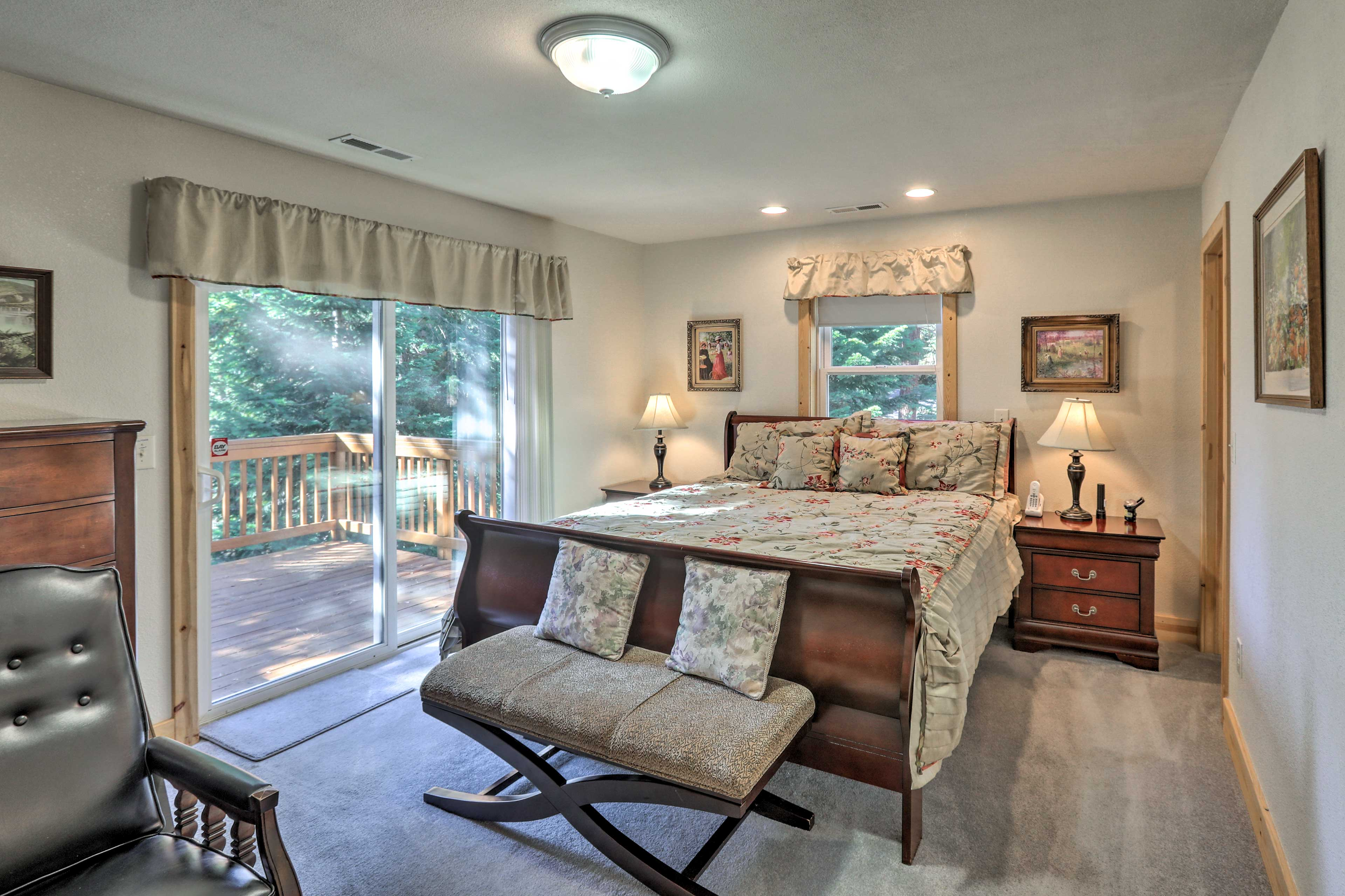 Slide onto the king bed in the spacious master bedroom.