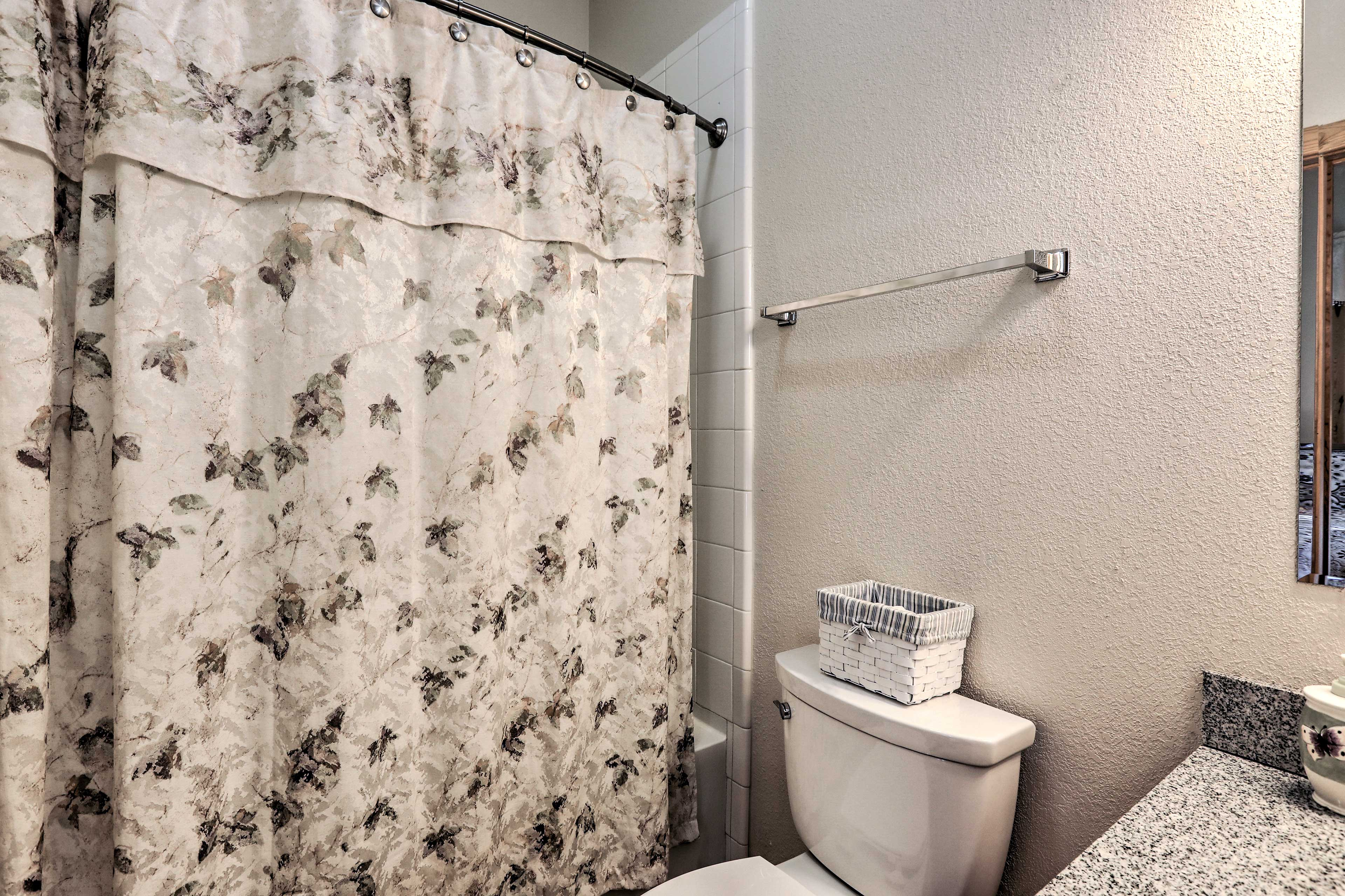 This room also has a shower/tub combo for any bath lovers.
