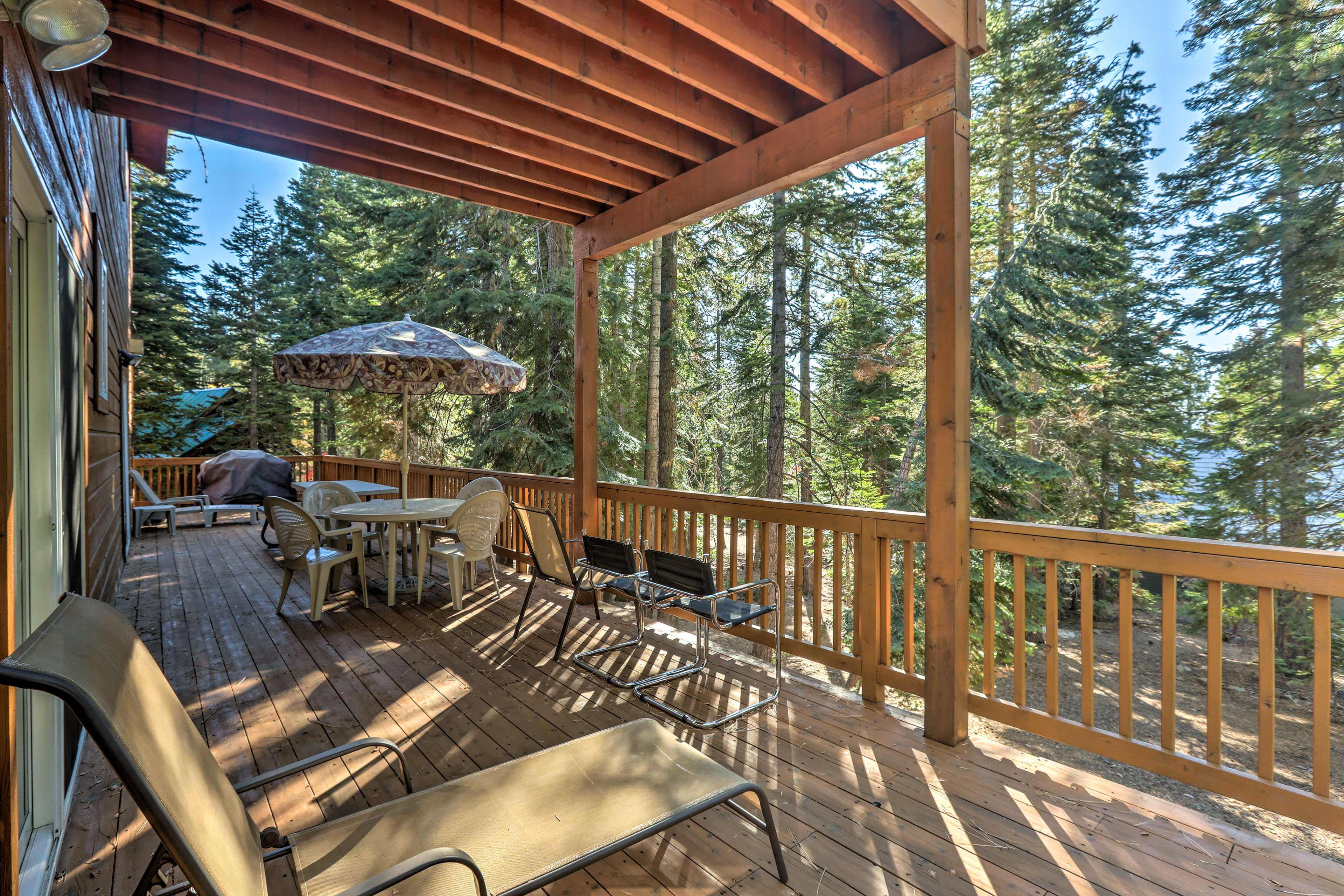 Pour a glass of wine and enjoy the scenic forested views surrounding the home.