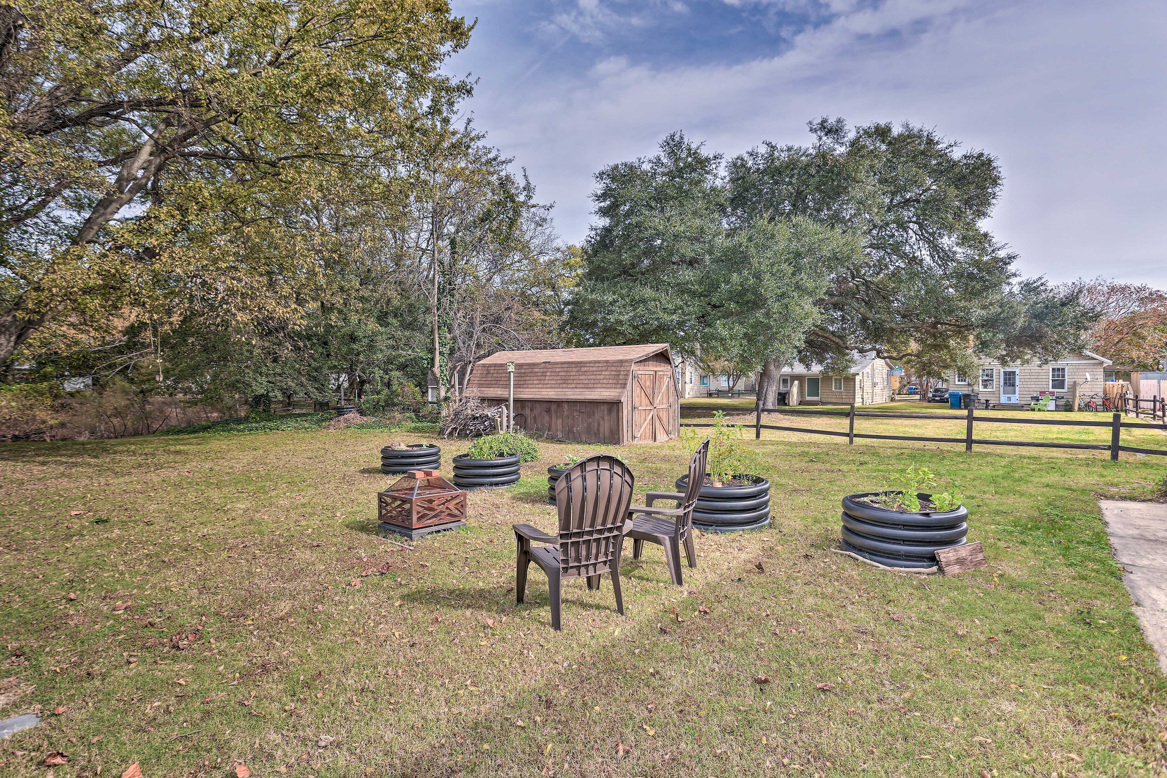 This property boasts a beautiful backyard complete with a fire pit and sunroom!