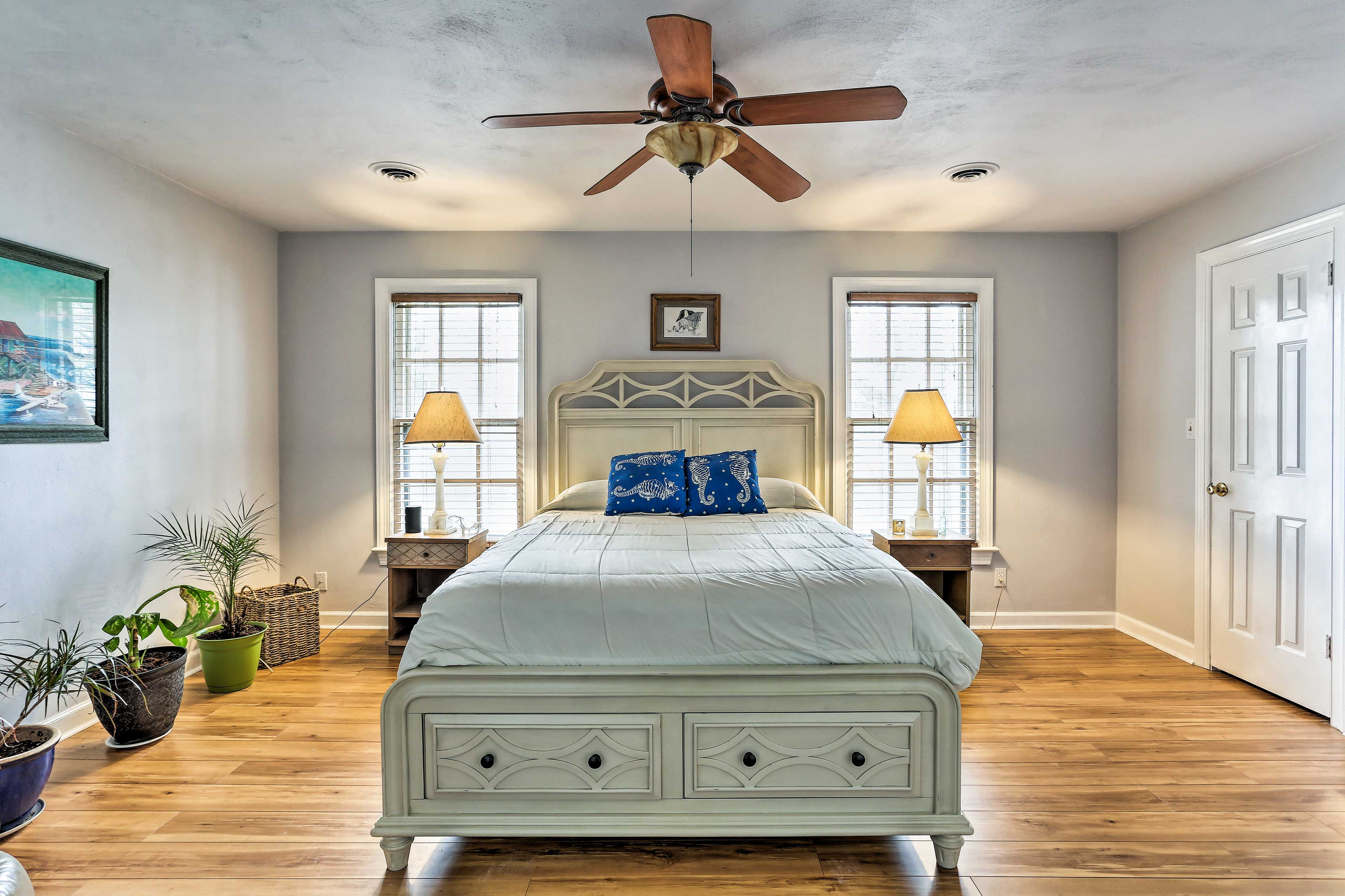The first bedroom features a queen bed and flat-screen Smart TV.