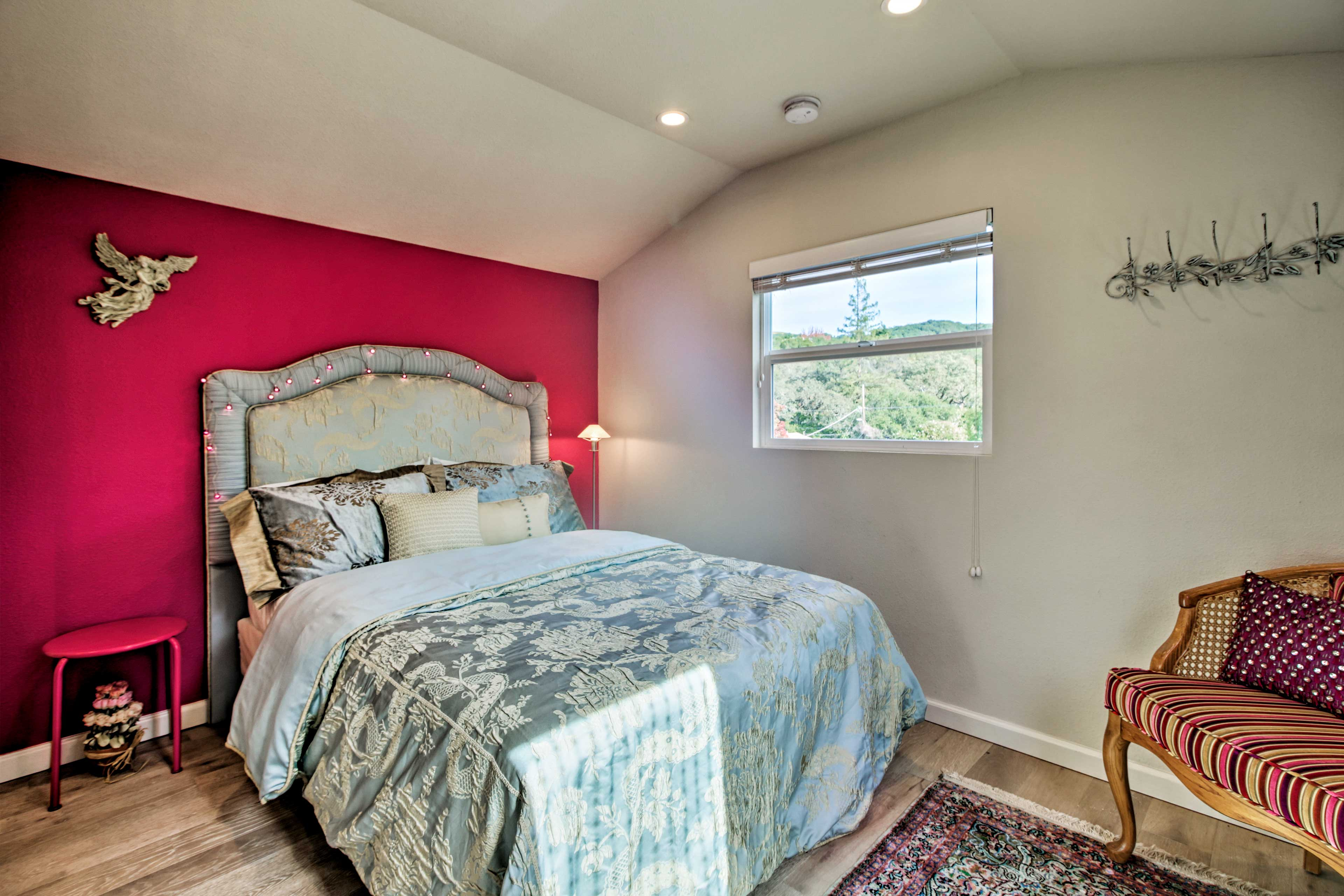 The bedroom boasts a lustrous full.
