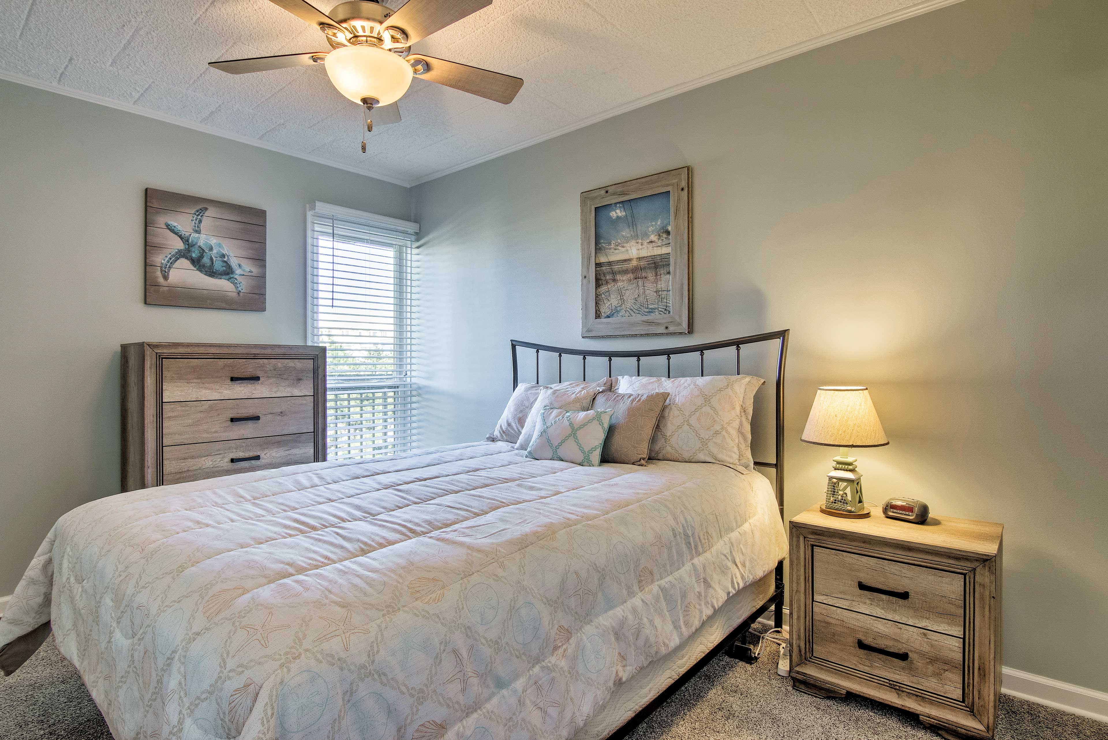 Claim the master bedroom's queen bed as your own.
