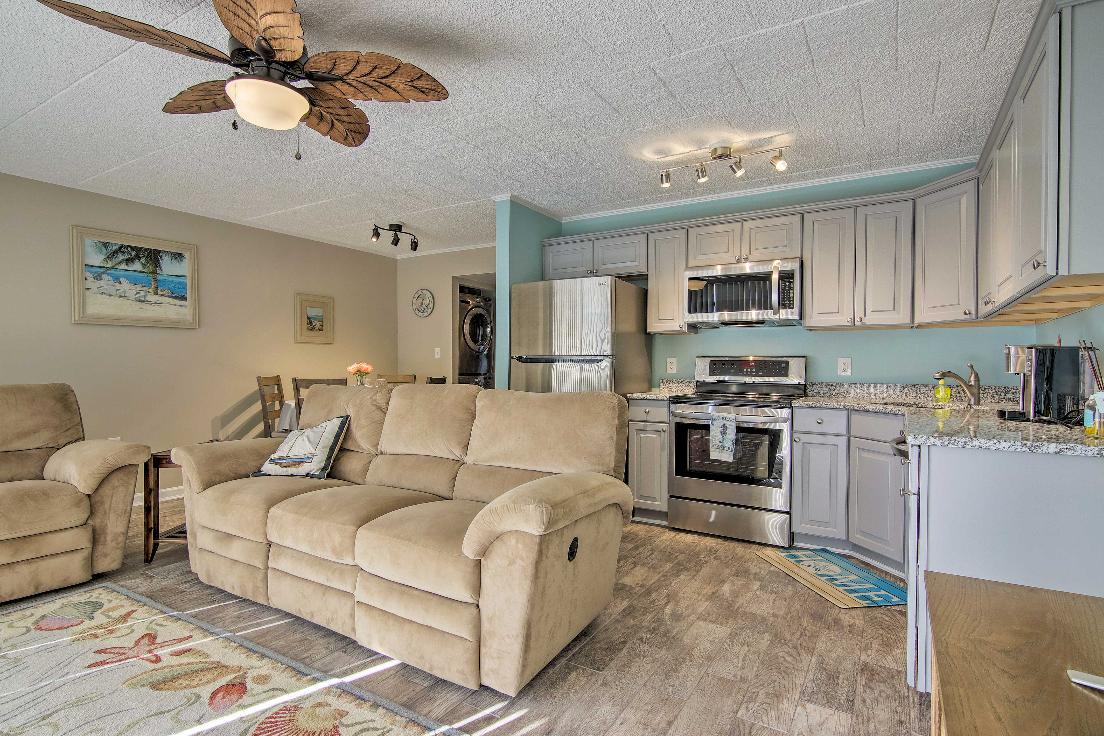 The open-concept layout is home to both the living room and kitchen.