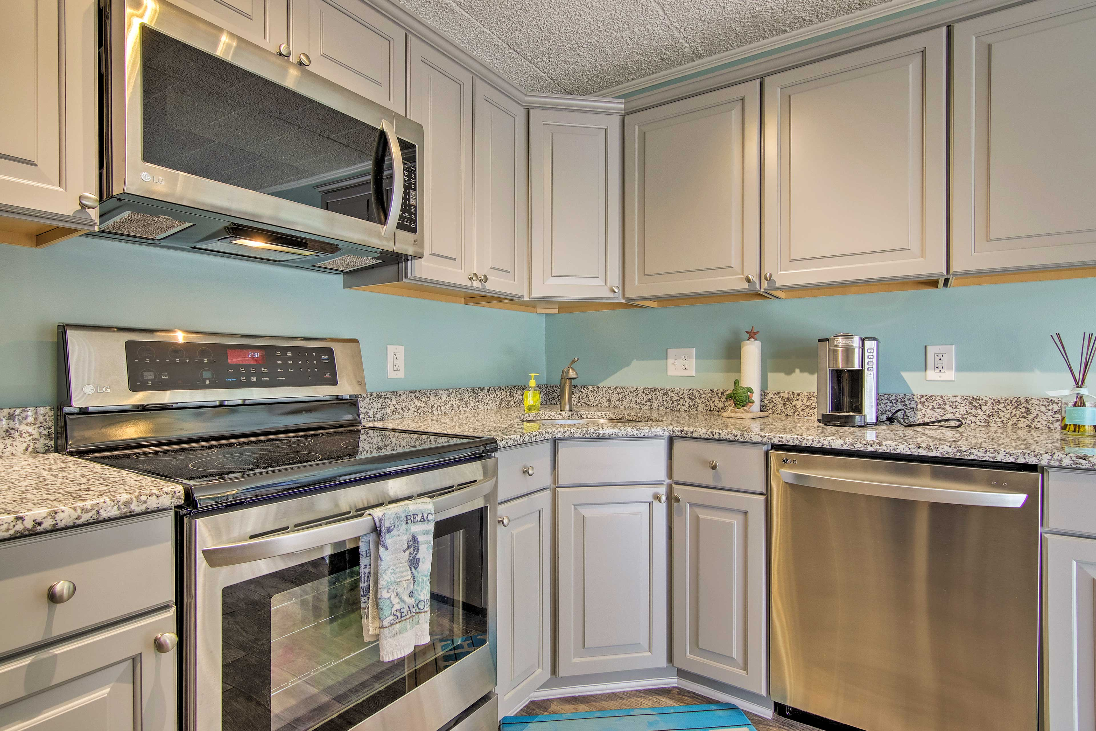 Stainless steel appliances & granite counters create an elegant cooking space.