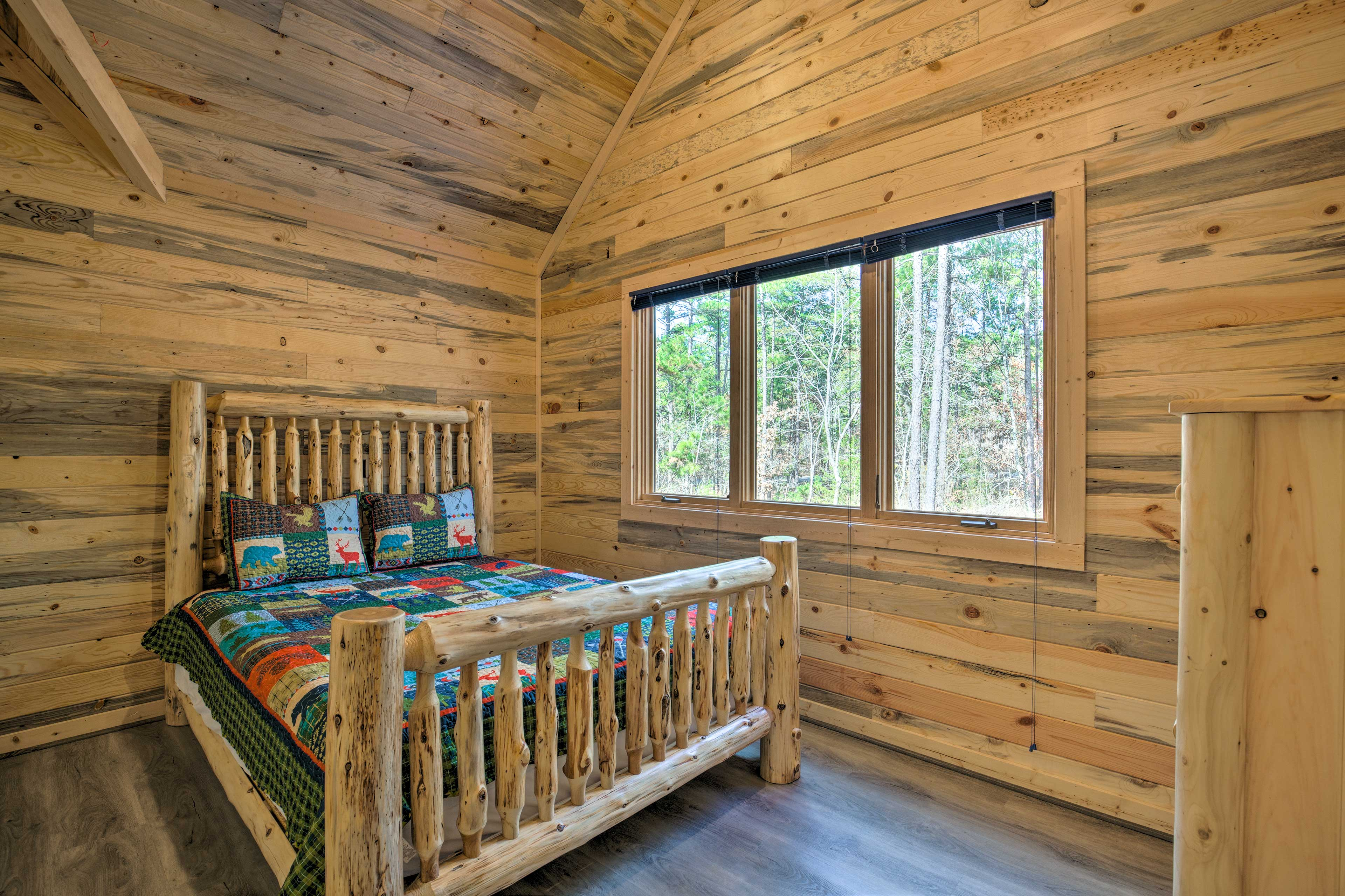 Wake up to tranquil forest views from this king bed.