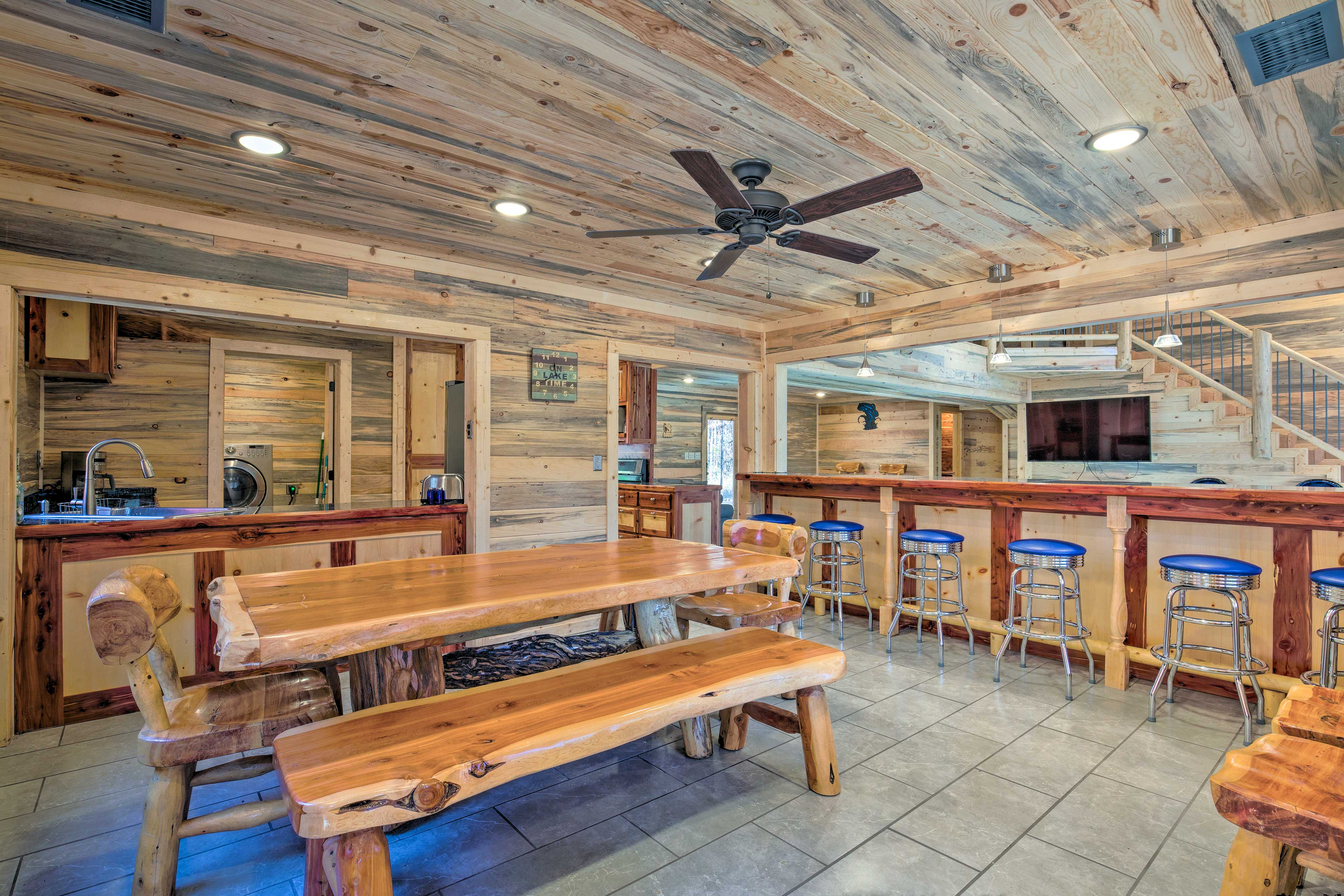 Find additional seating at the rustic wooden table nearby.