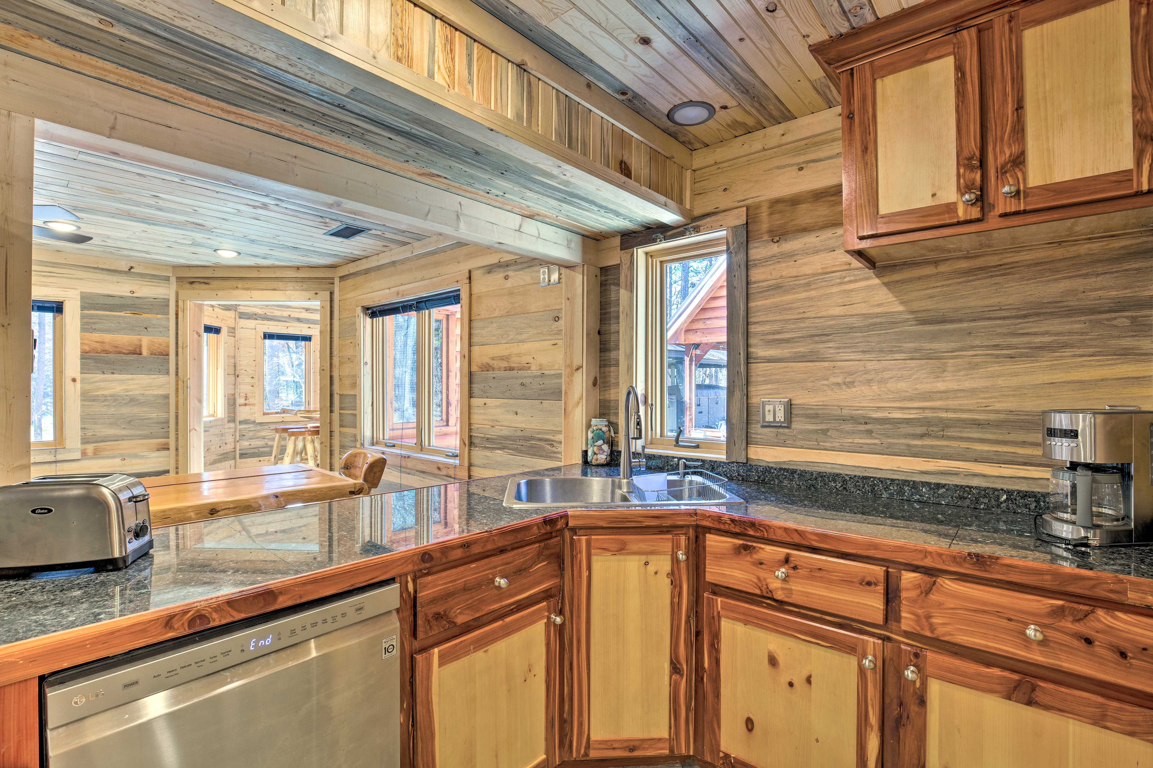 Wraparound counters and a pass-through window outfit the fully equipped kitchen.