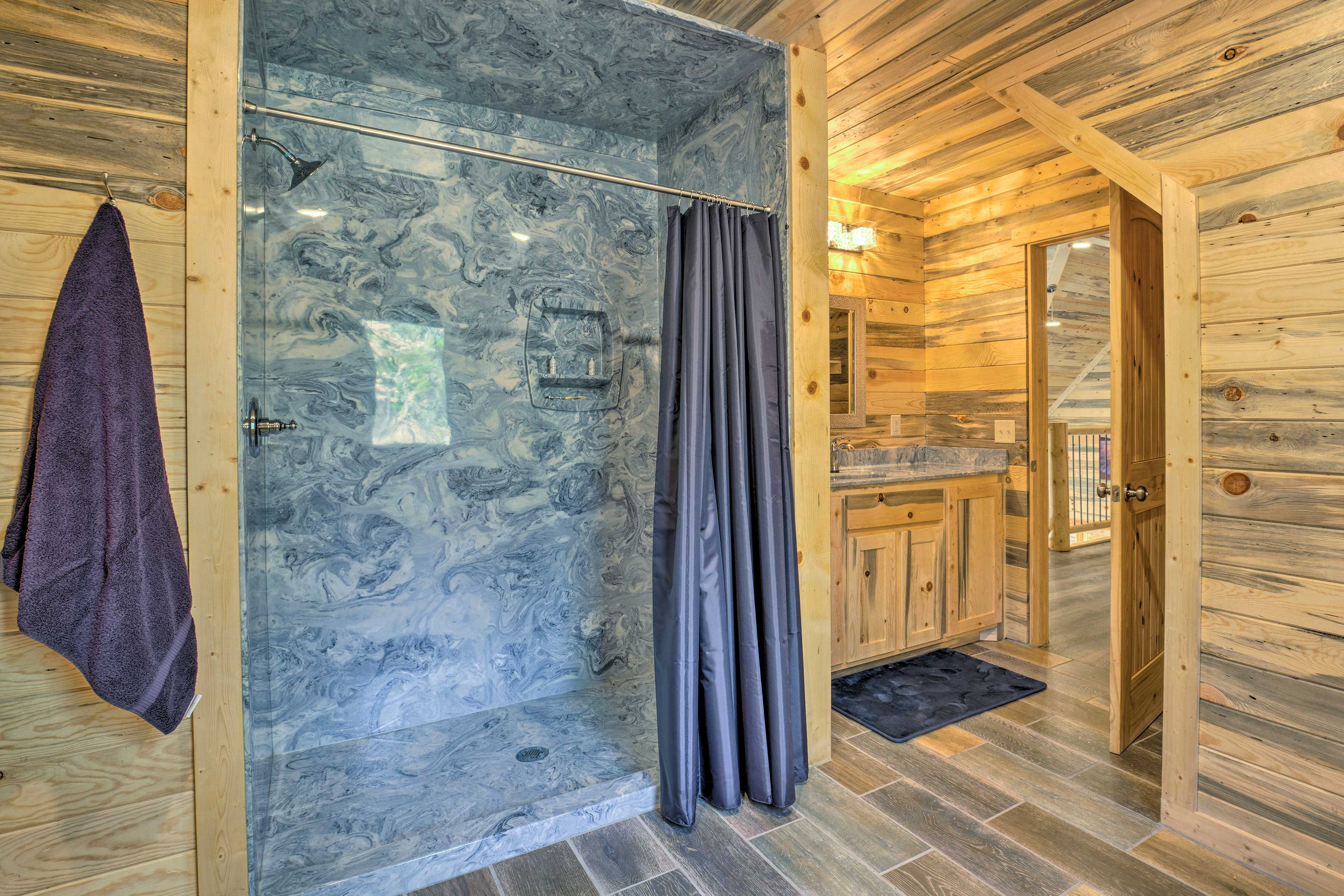 This upstairs bathroom is equipped with a roomy shower.