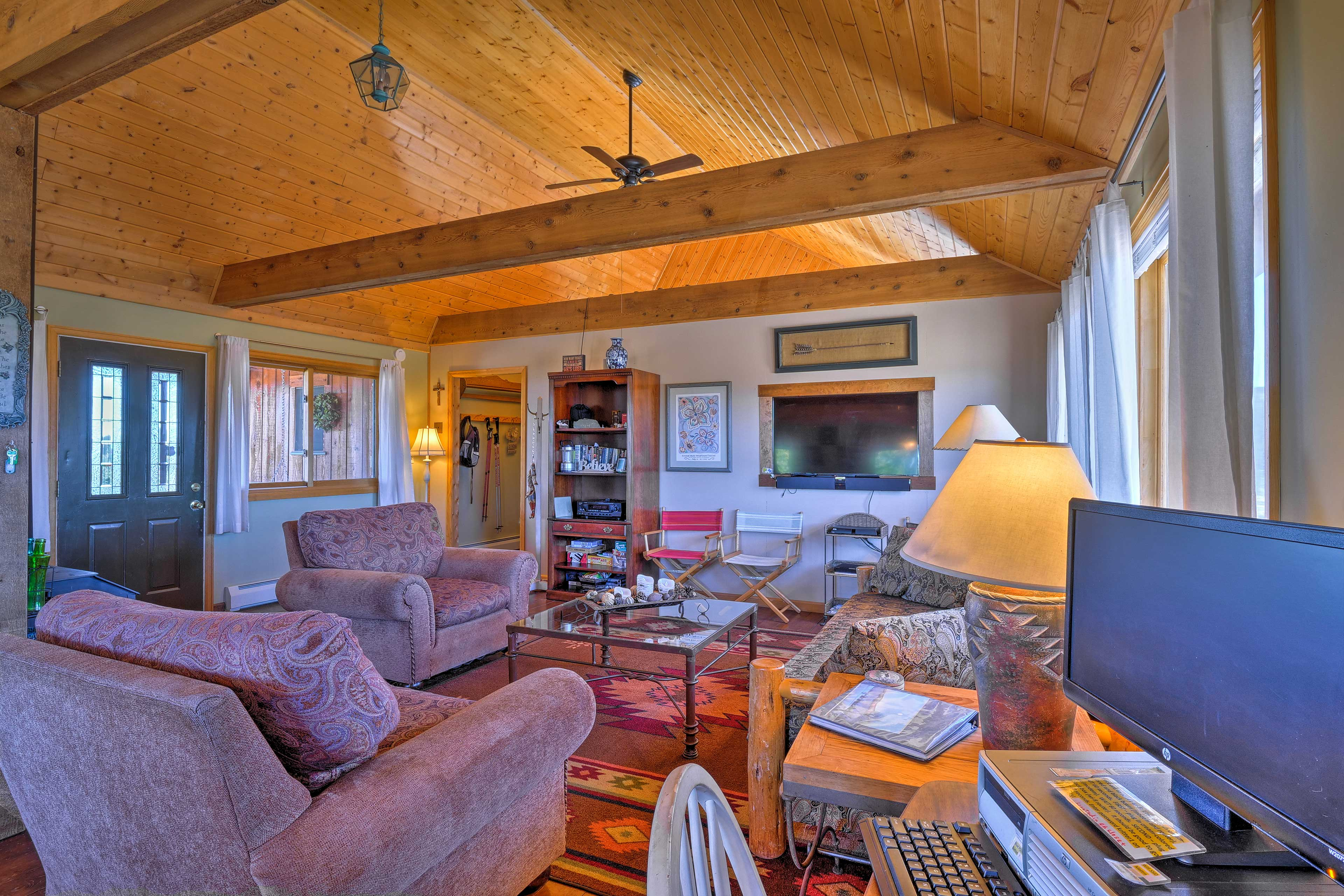 A slanted wood paneled tongue & grooved ceiling adds rustic character.