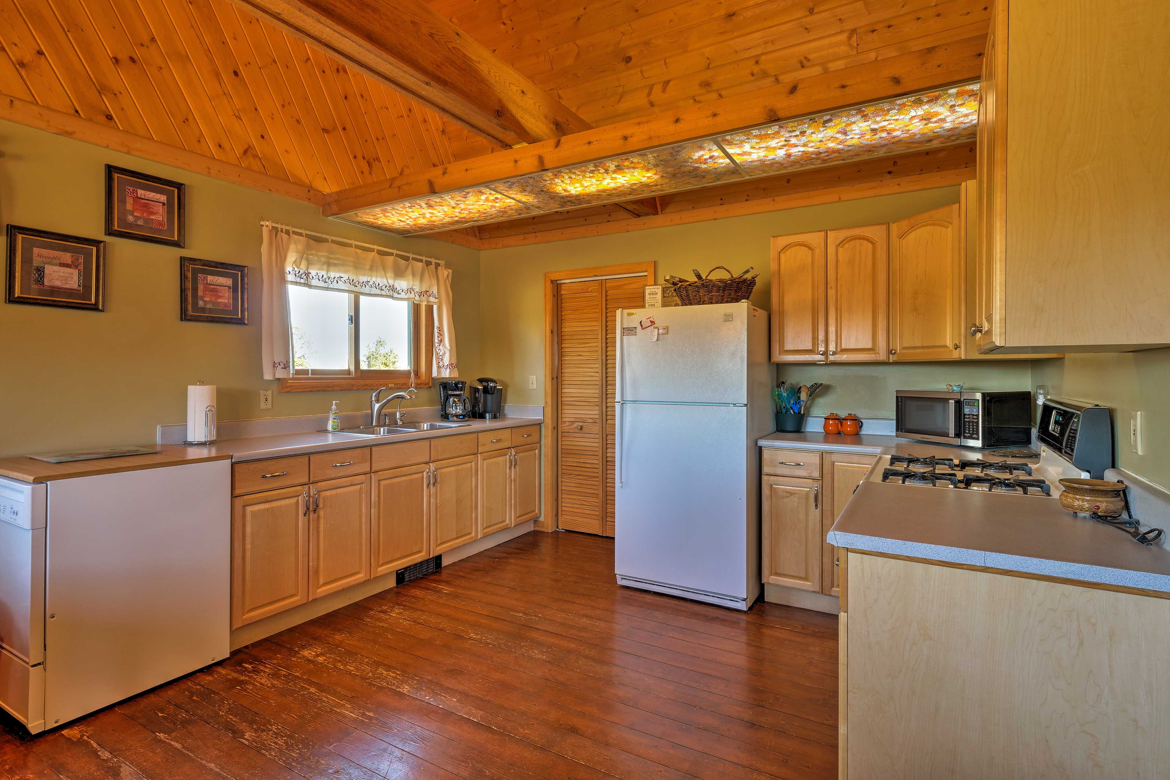 This kitchen is fully equipped to provide convenient meal preparations.