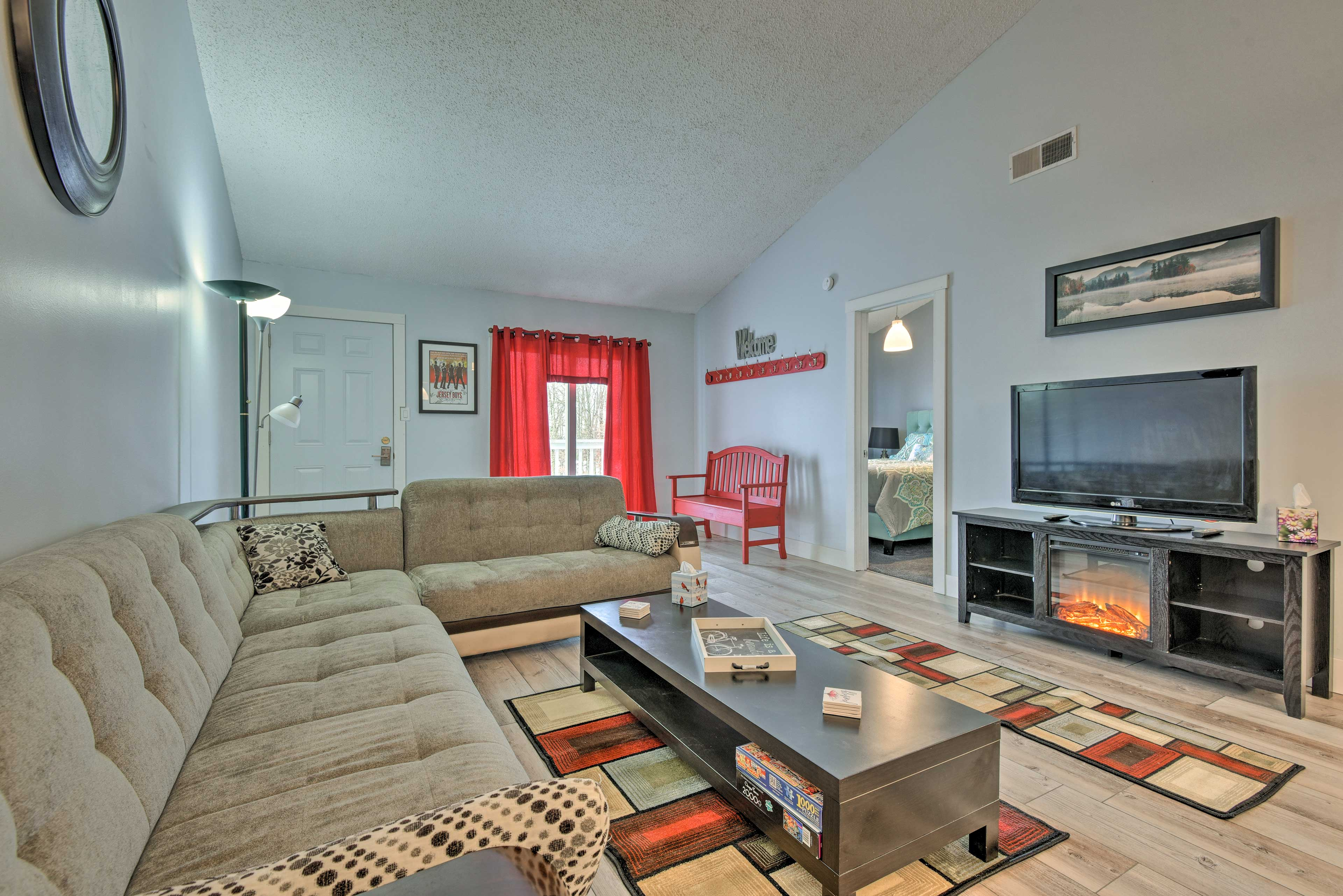 There is also an electric fireplace and flat-screen cable TV in the living room.