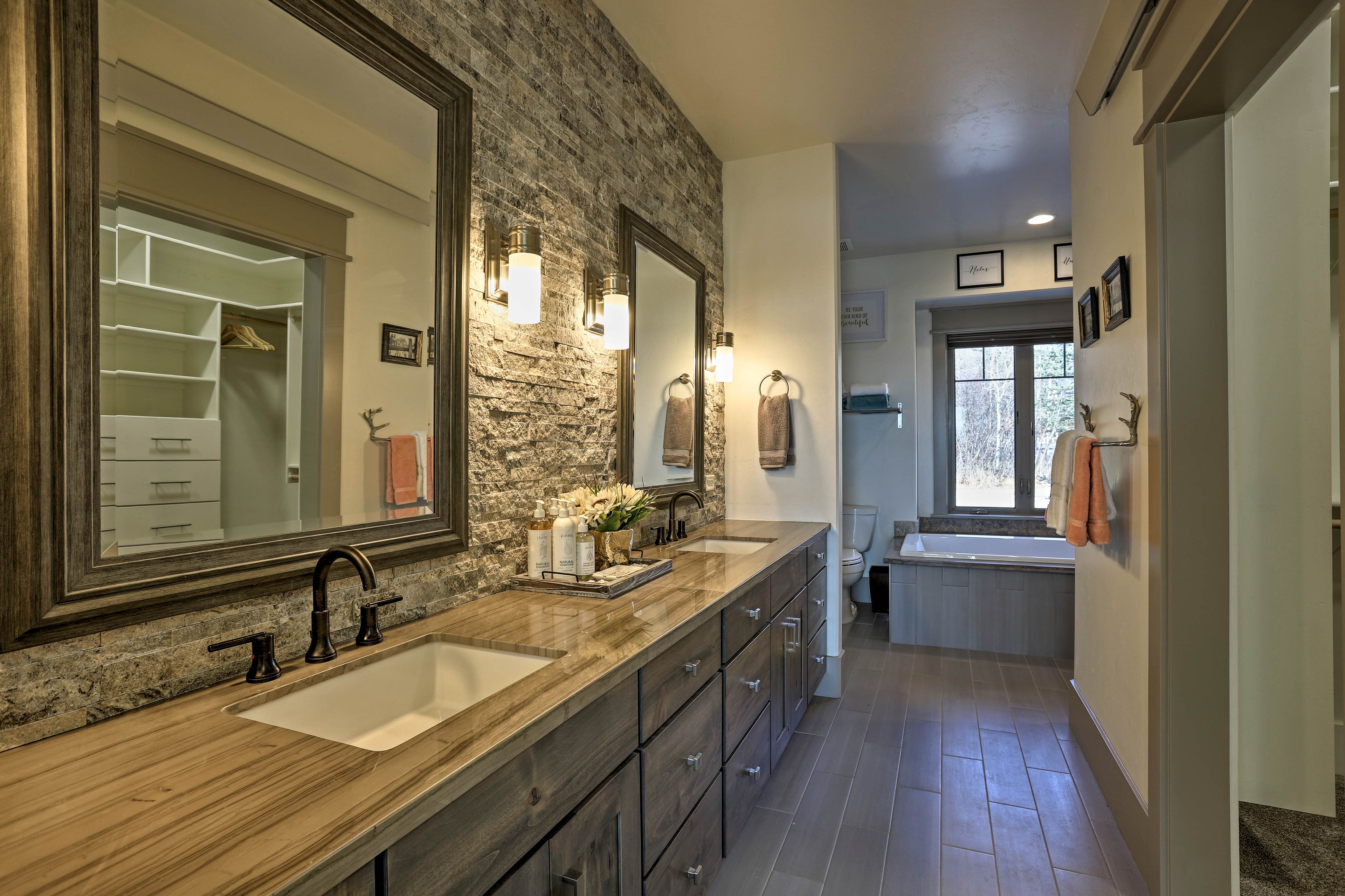 The master bedroom boasts an extensive double vanity for 2.