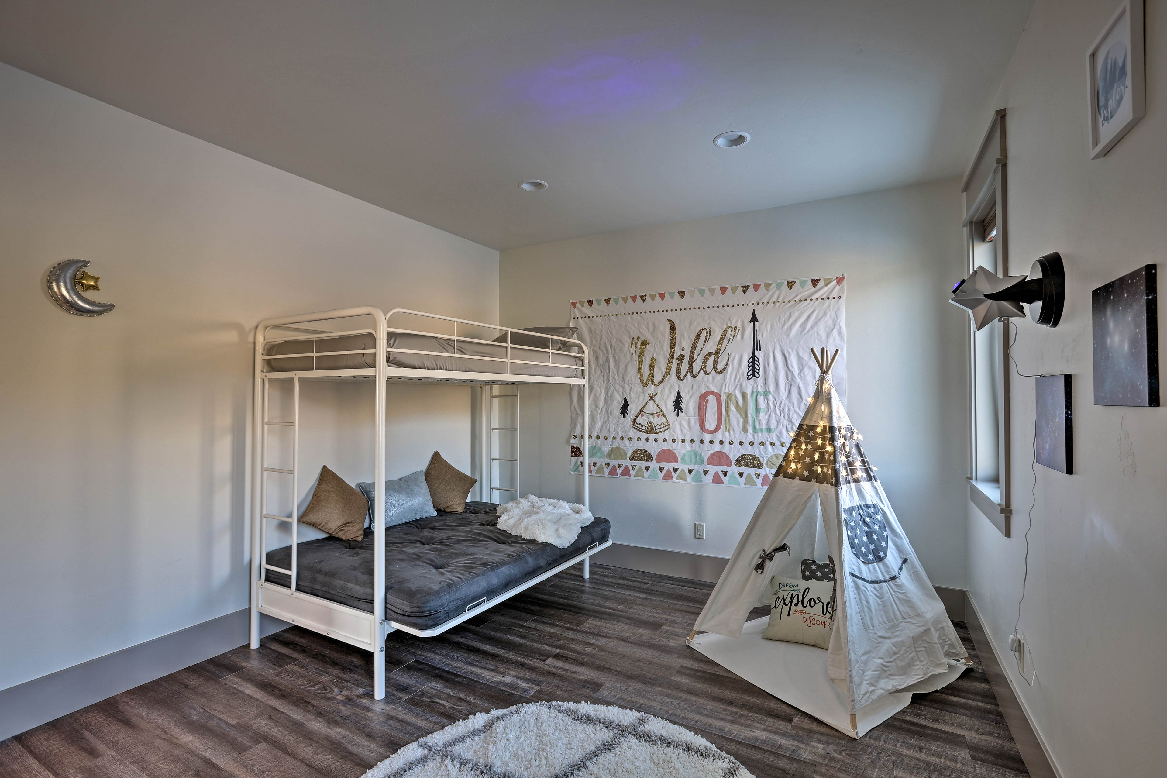 The fifth bedroom features a twin-over-full bunk bed & a kids' teepee.