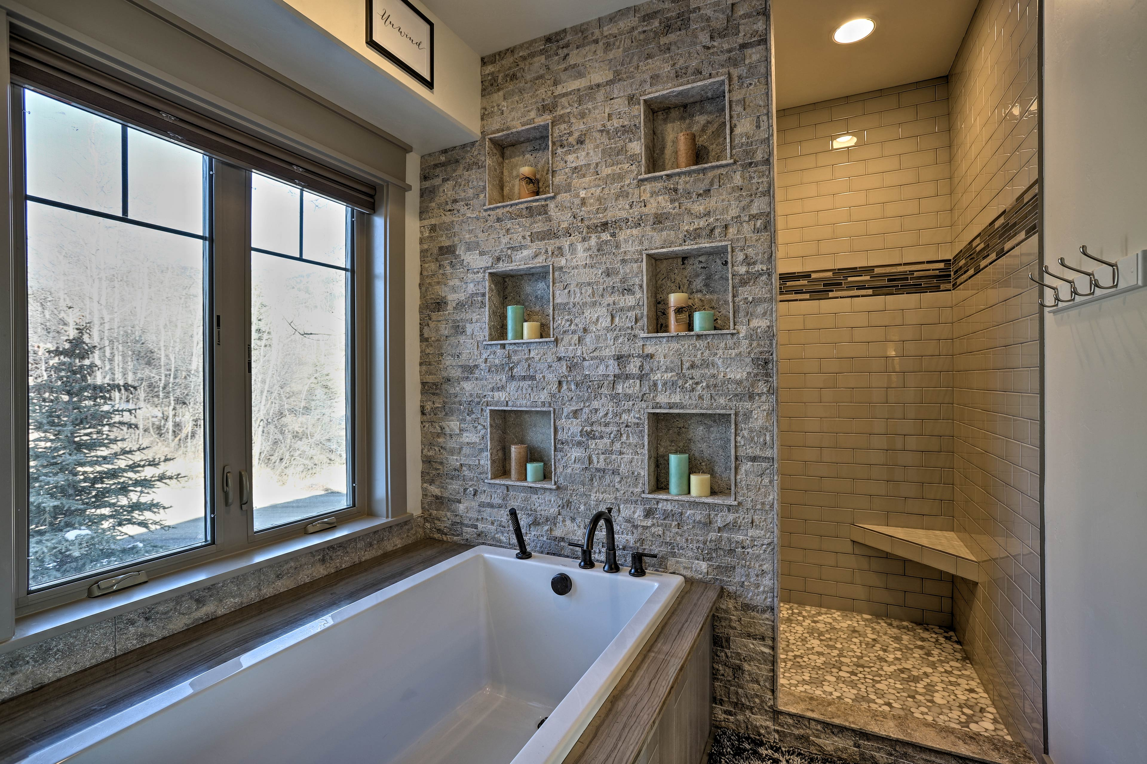Treat yourself to a bubble bath or rinse off in the luxurious doorless shower.