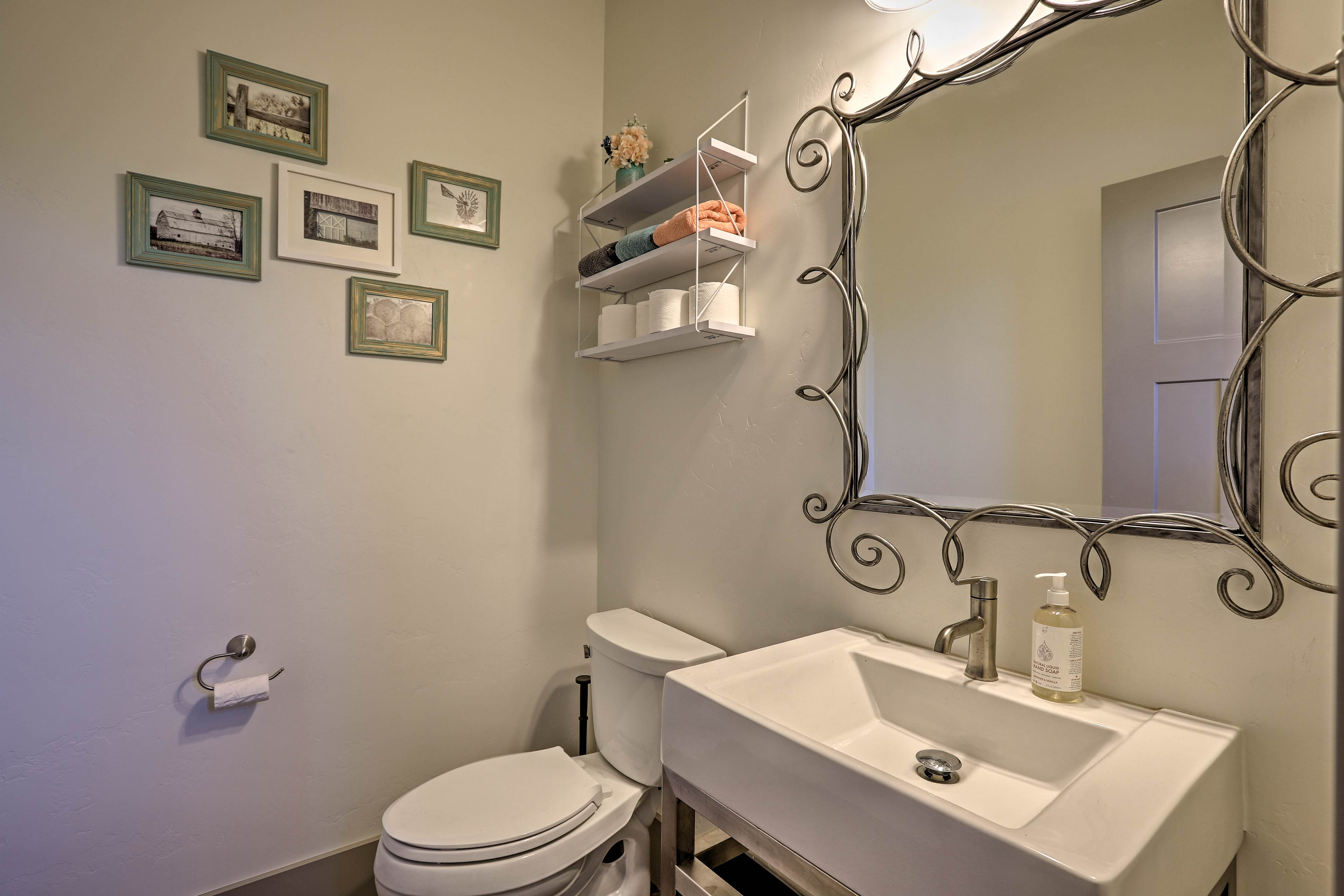 Wash your hands before dinner in this quaint half bath.