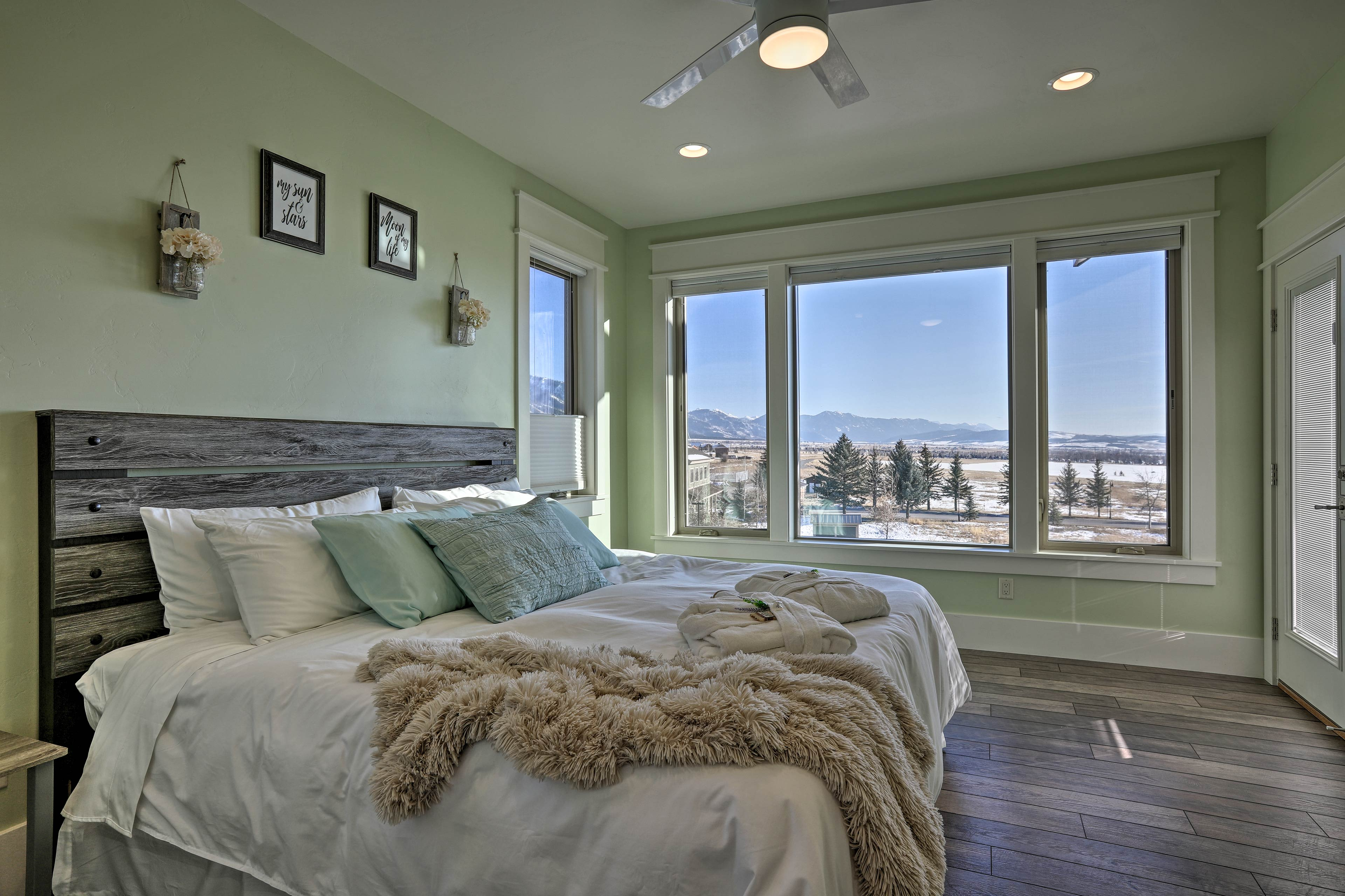 Snuggle under this plush bed's covers & fuzzy blankets as the sun rises.