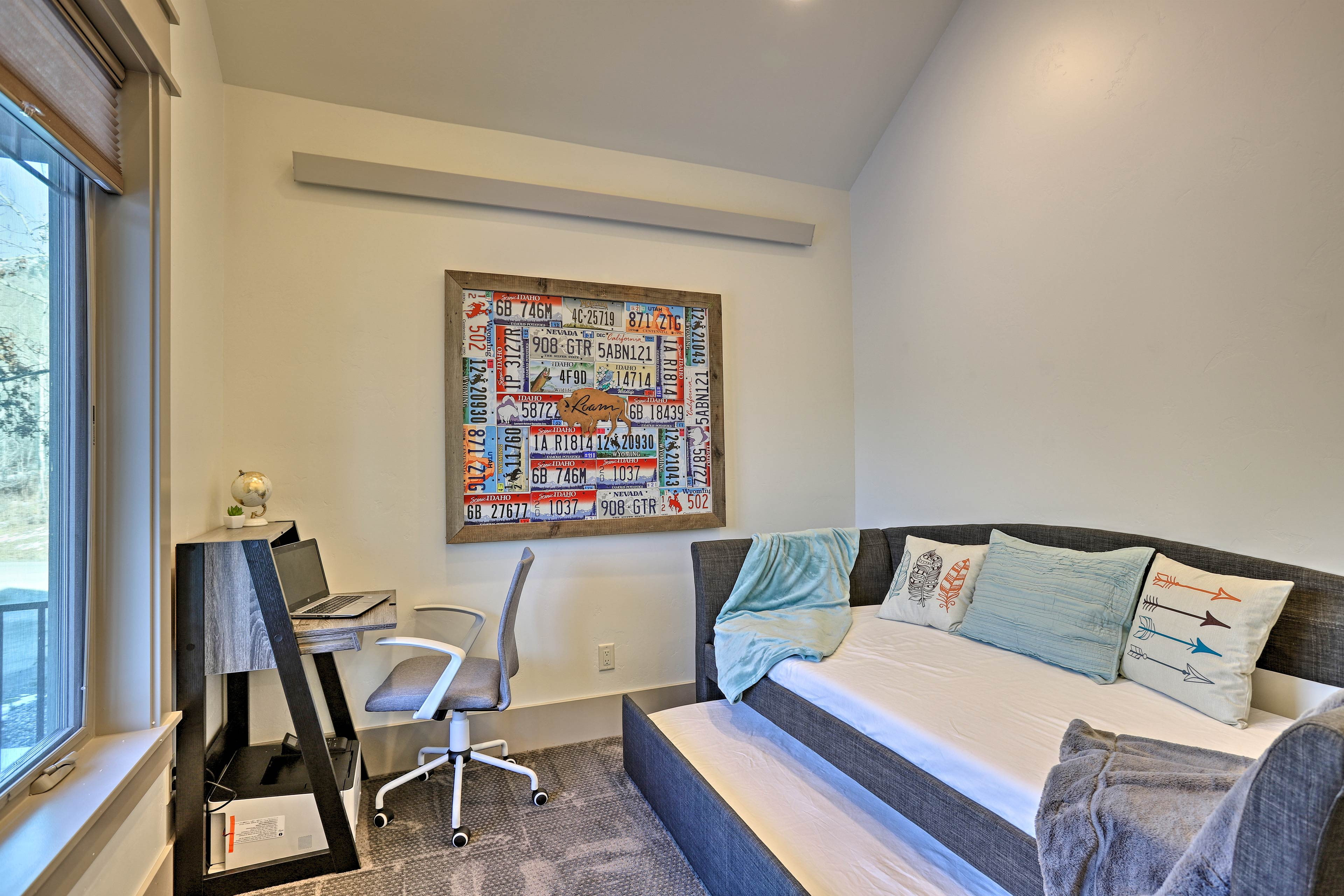 The second bedroom includes a twin bed with a twin trundle.