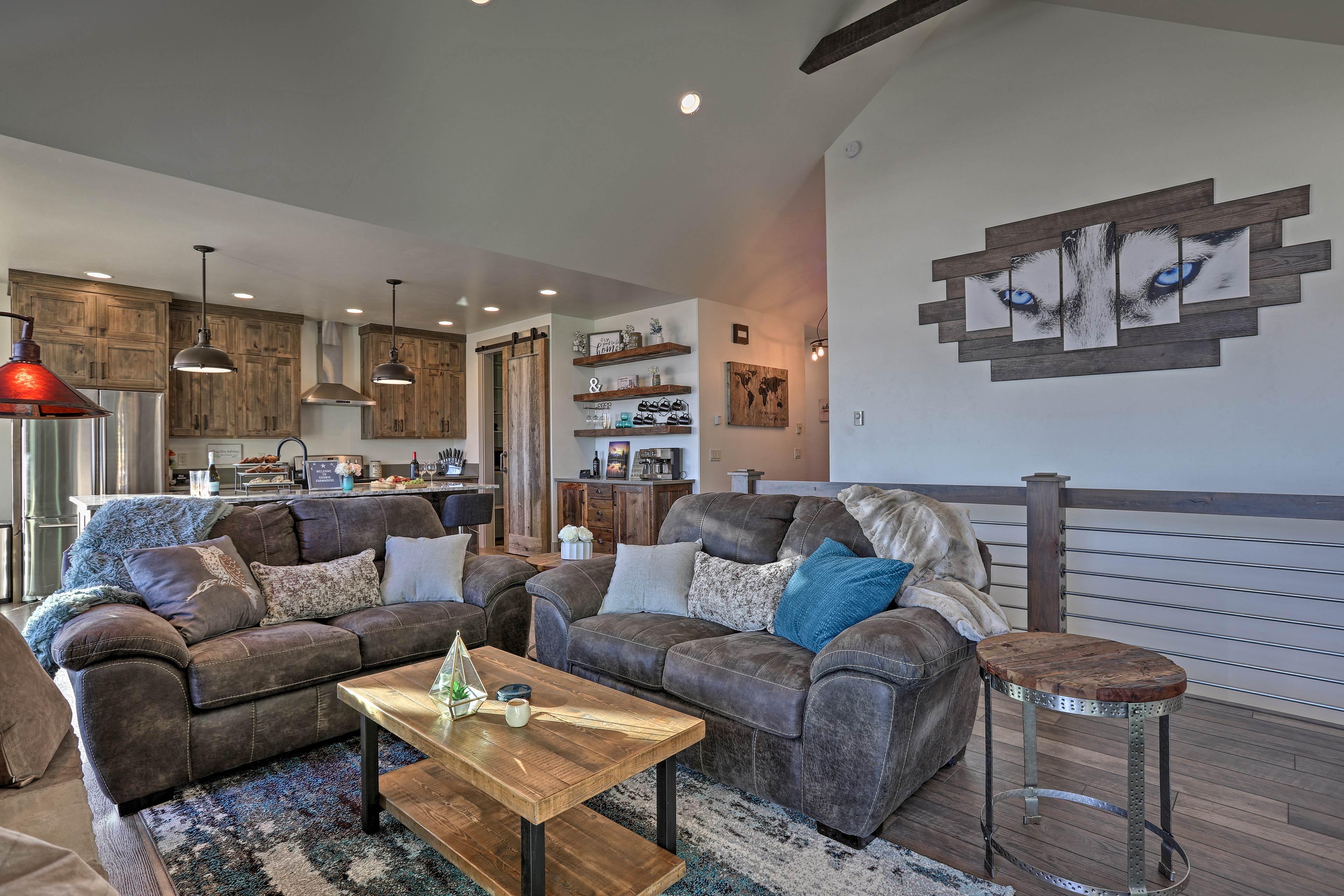 The open-concept living space boasts unique, tasteful decor.