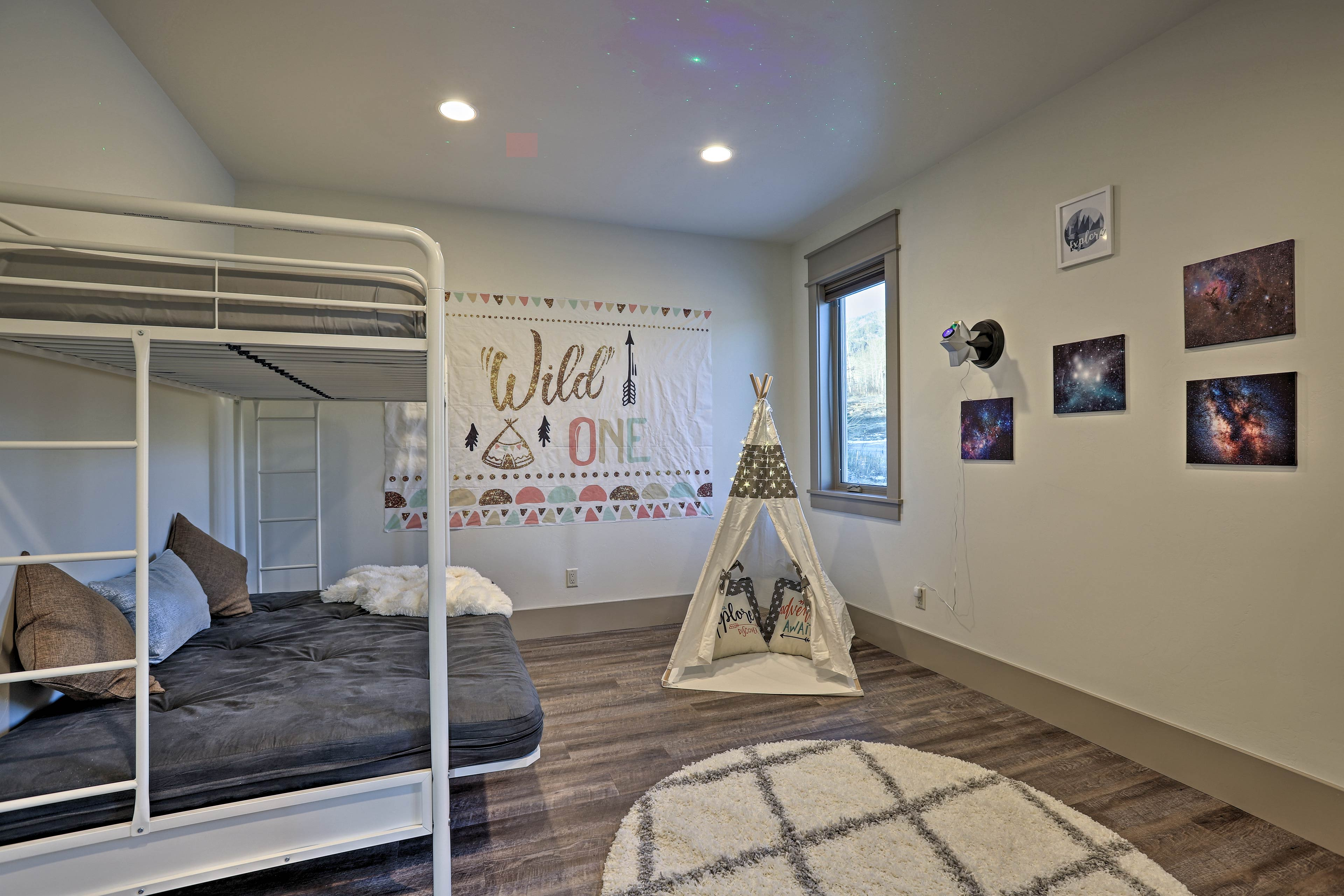 Tuck your kids into this endearing room & they'll fall sleep to the star lights.