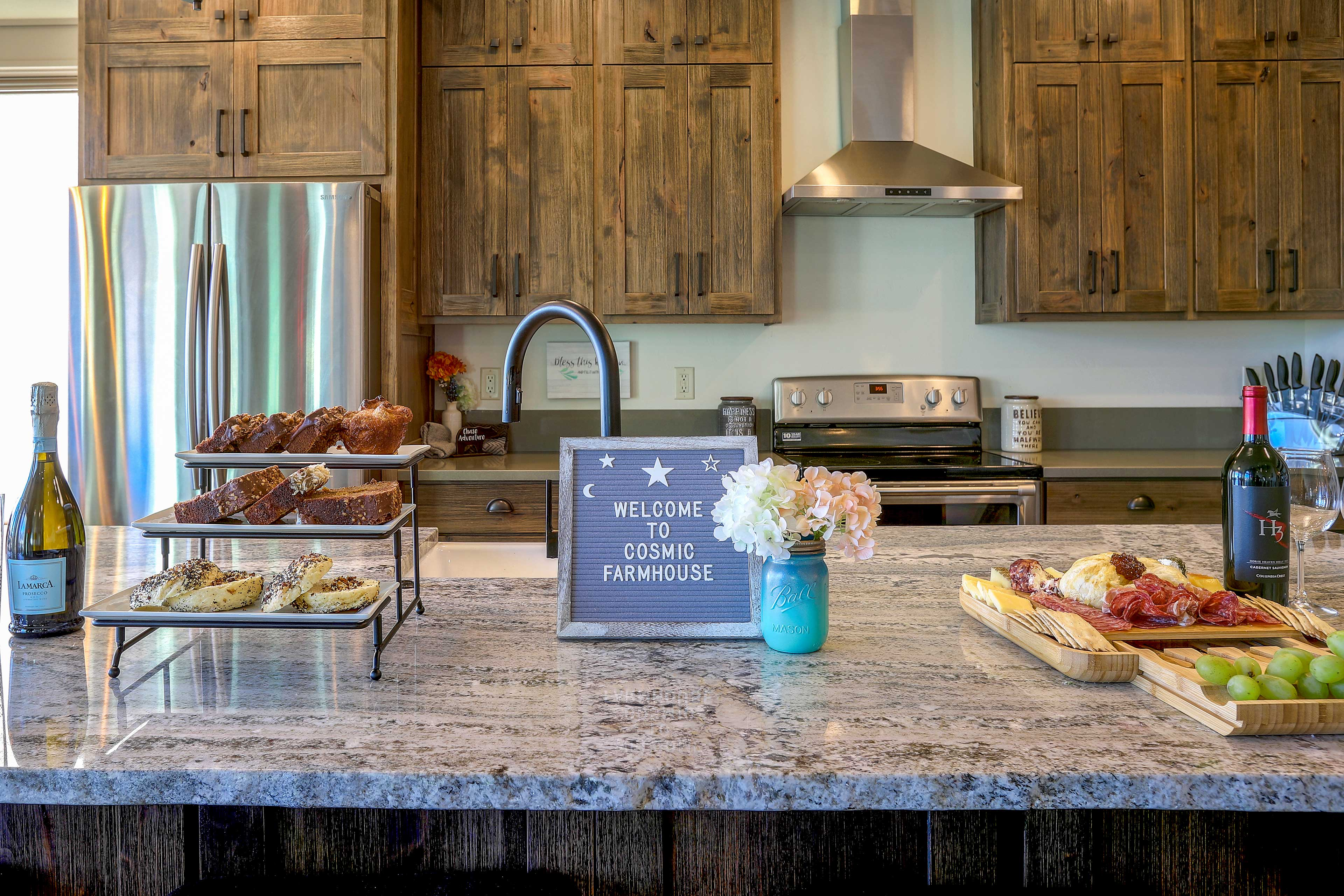 An impressive array of meats, cheeses, & baked goods welcomes you to the home.