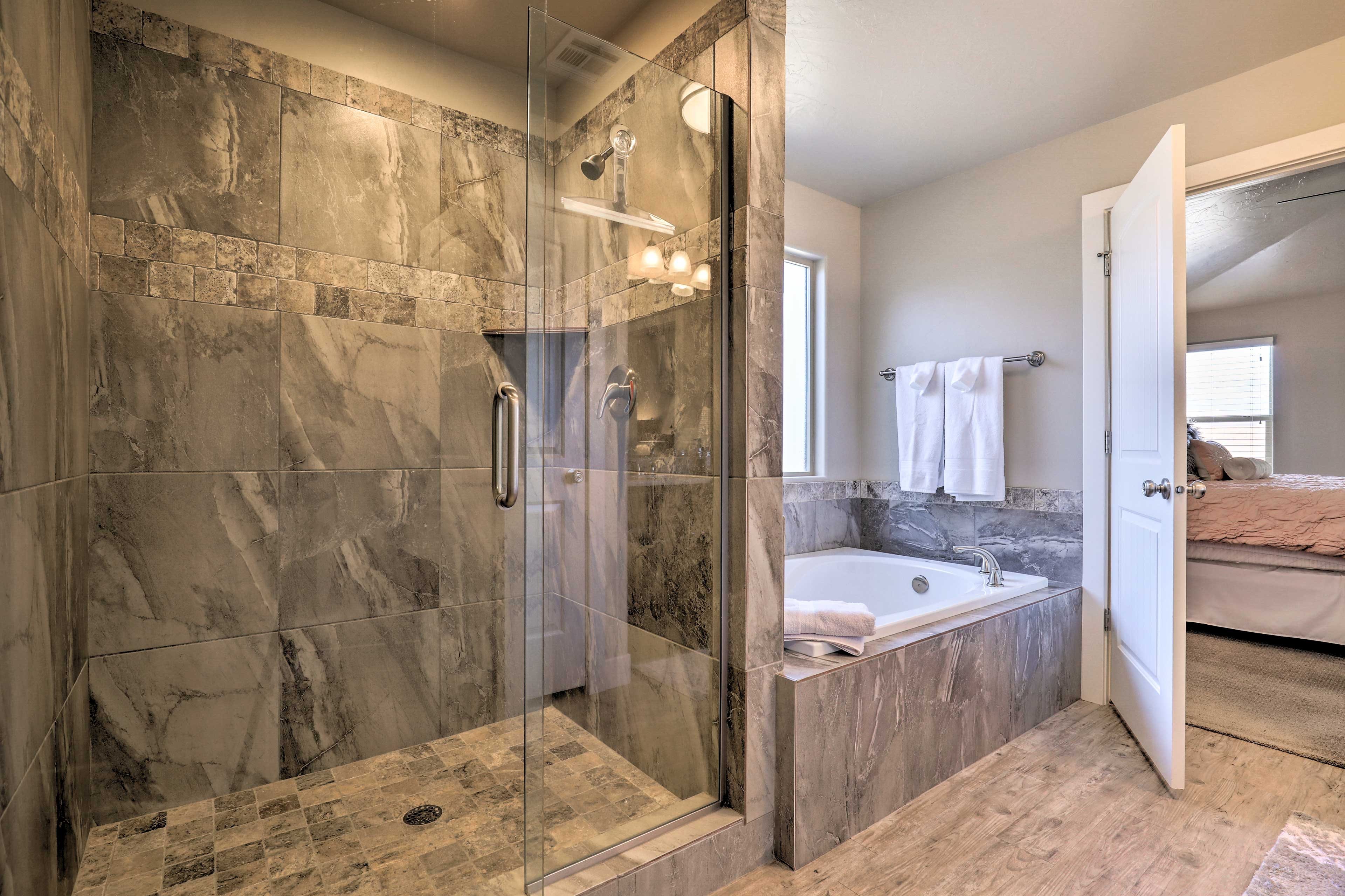 The en-suite bath features a tub and luxurious walk-in shower.