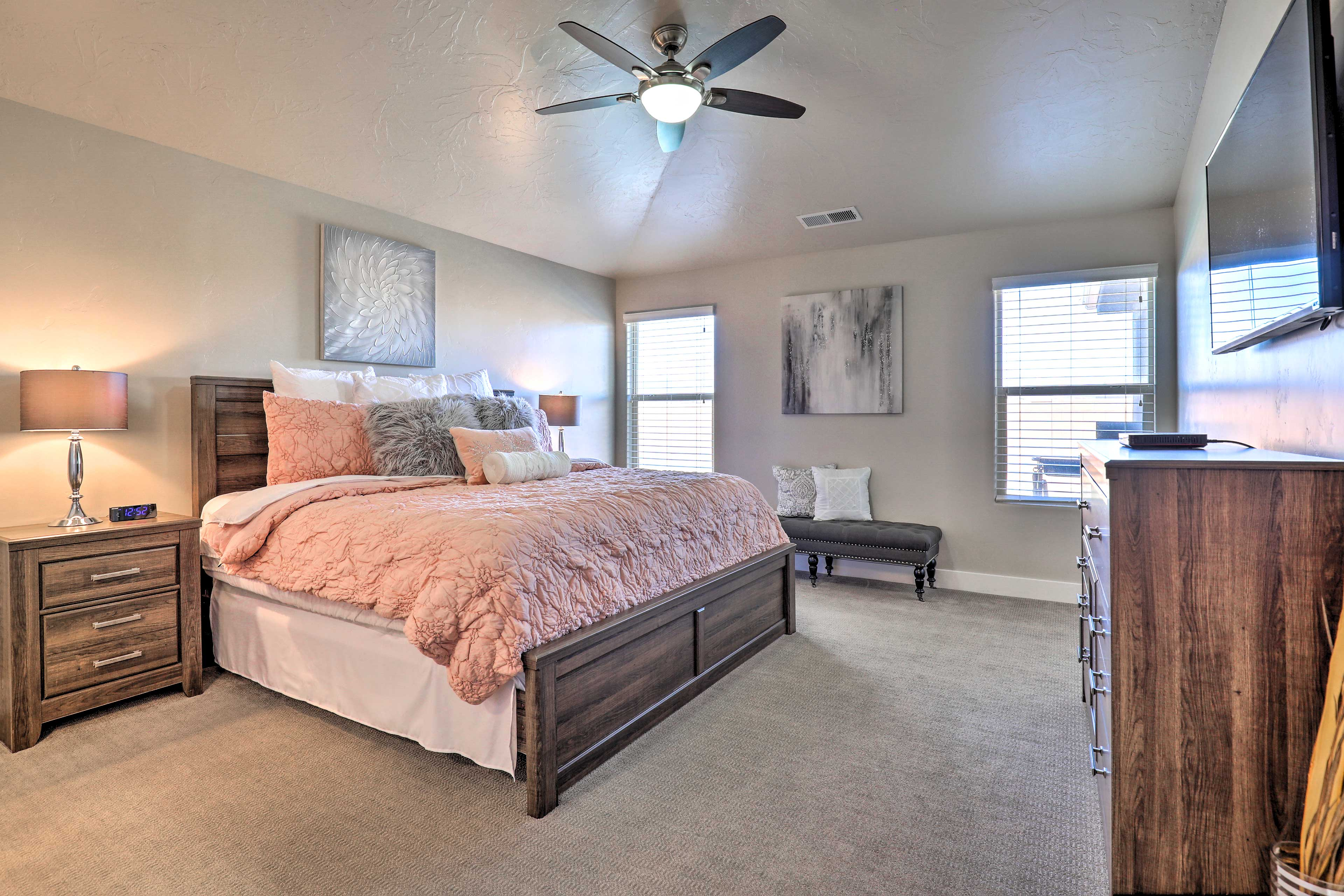 The master bedroom features a cozy king bed.