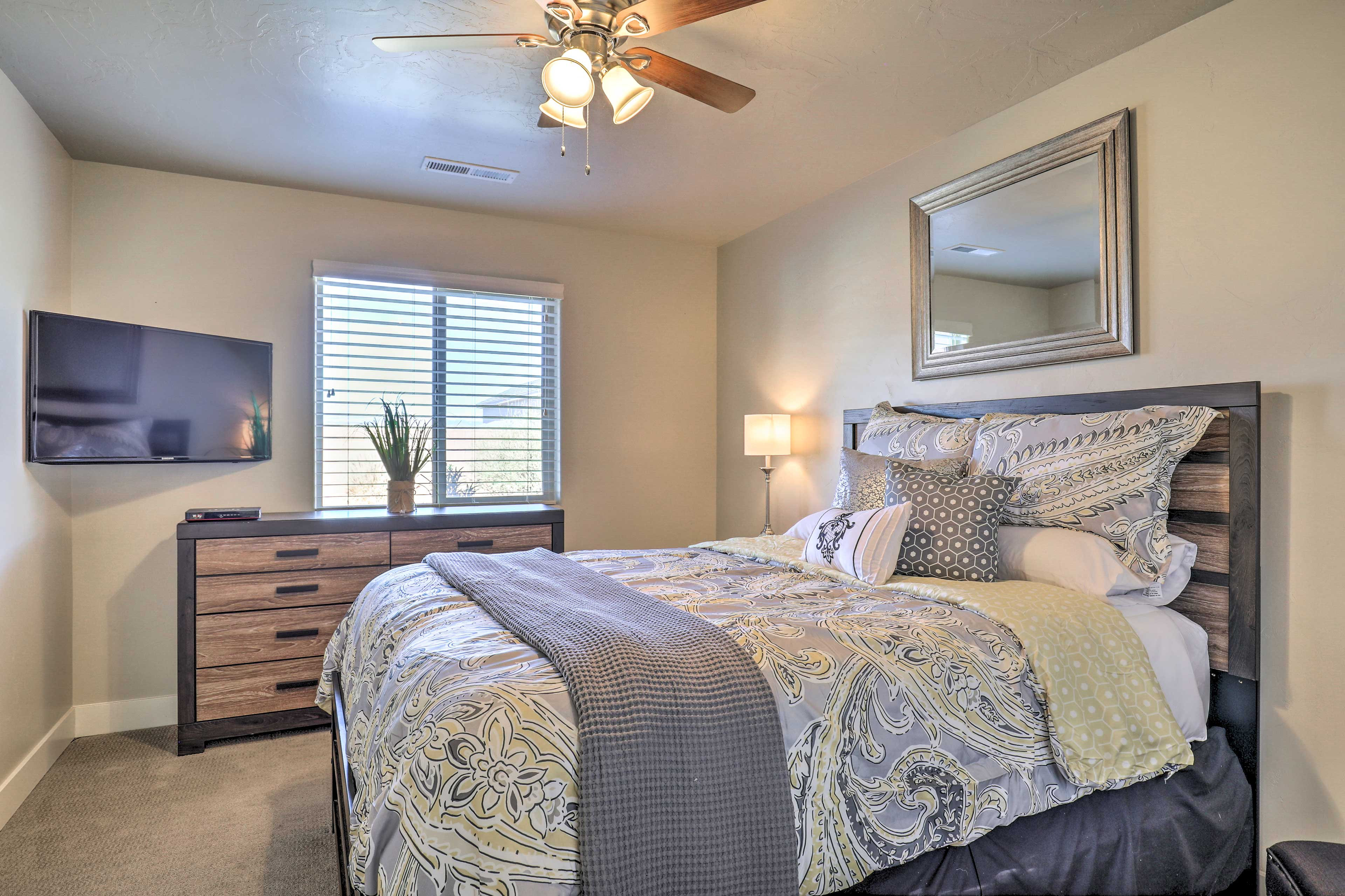 The second bedroom also features a flat-screen TV.