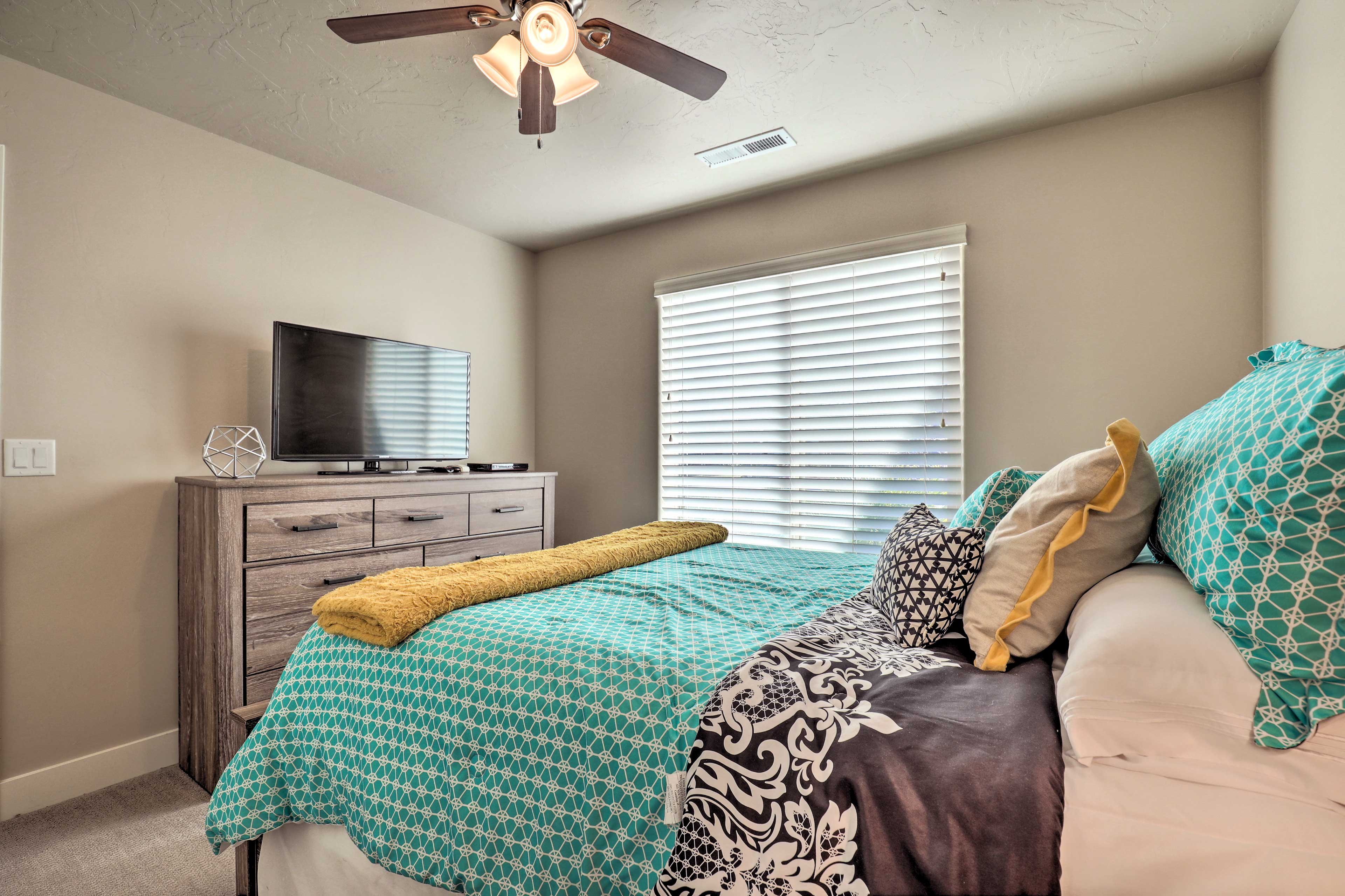A fourth room hosts a queen bed.