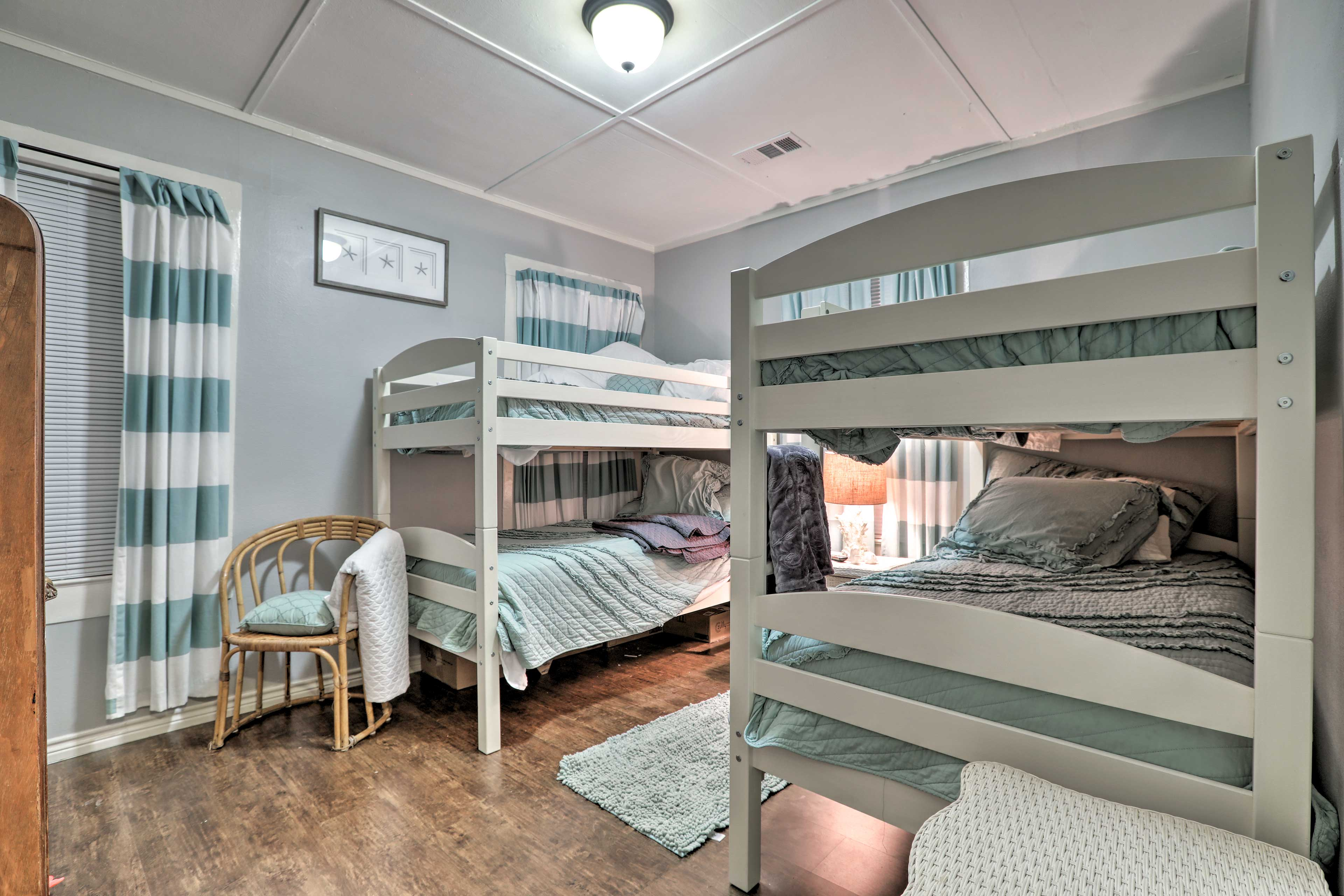 The second bedroom provides 2 twin-over-twin bunk beds.
