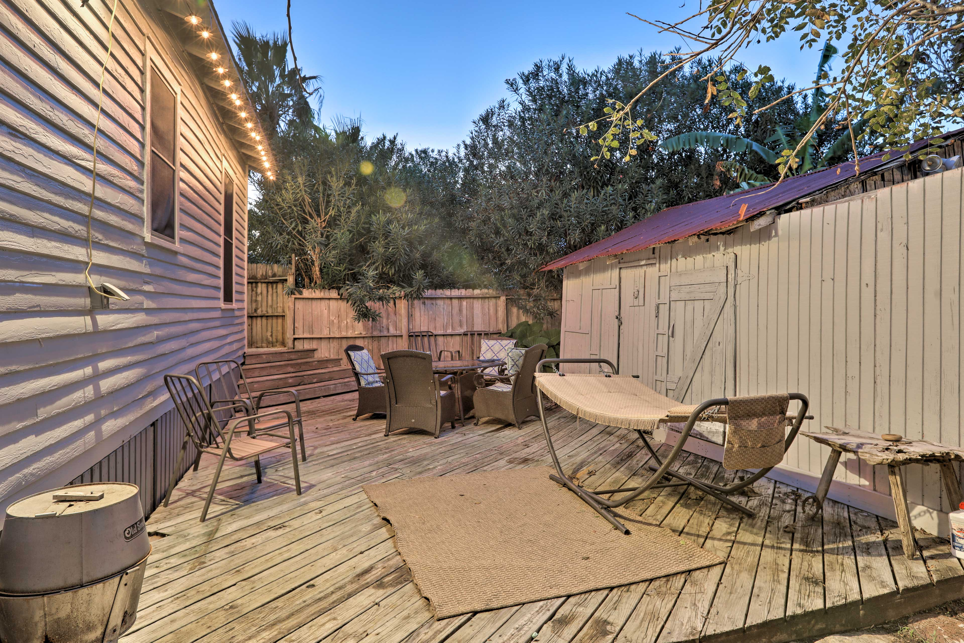 Your group of 6 will love lounging in the private fenced backyard.