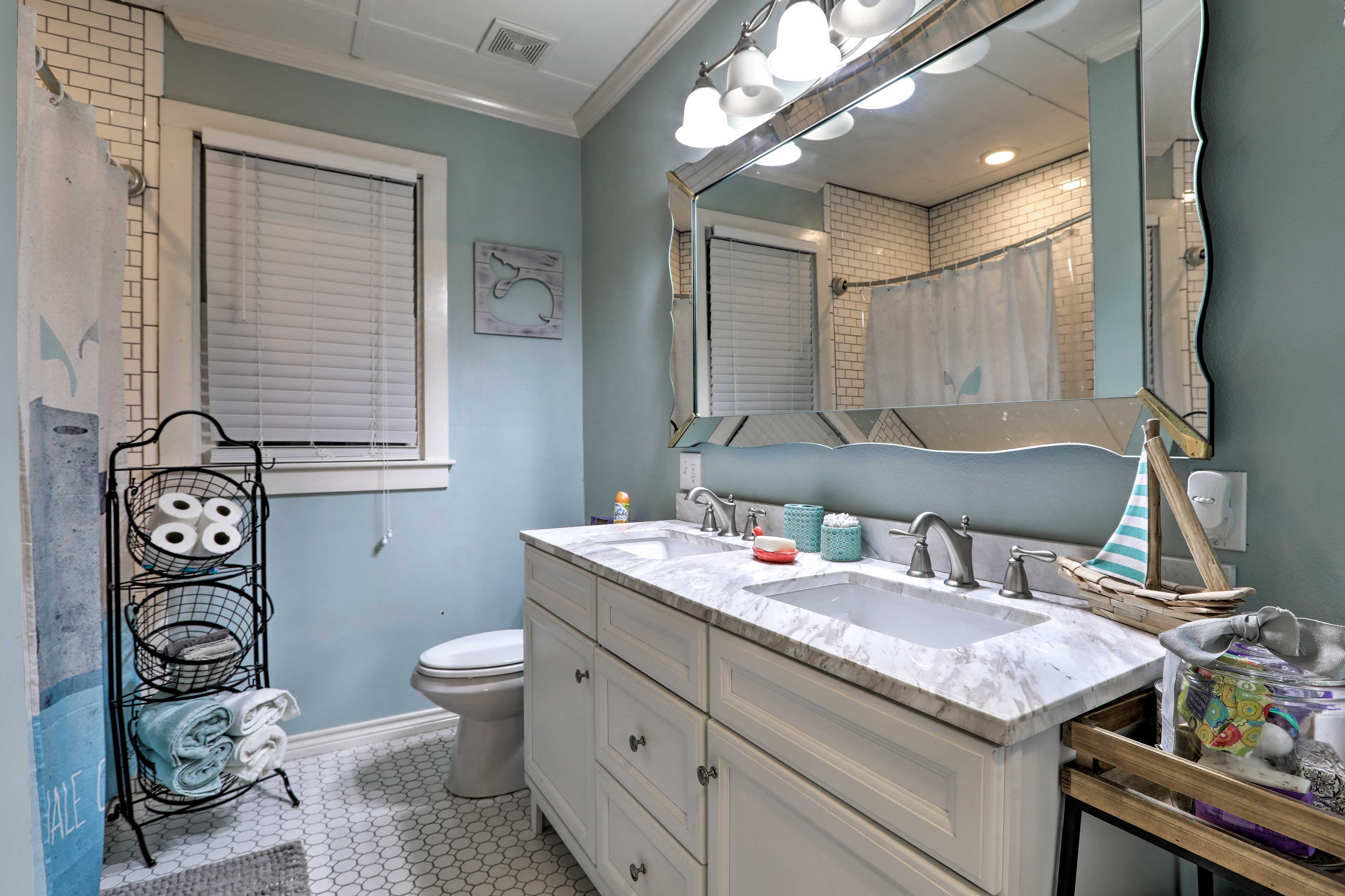 This full bathroom includes a double vanity.