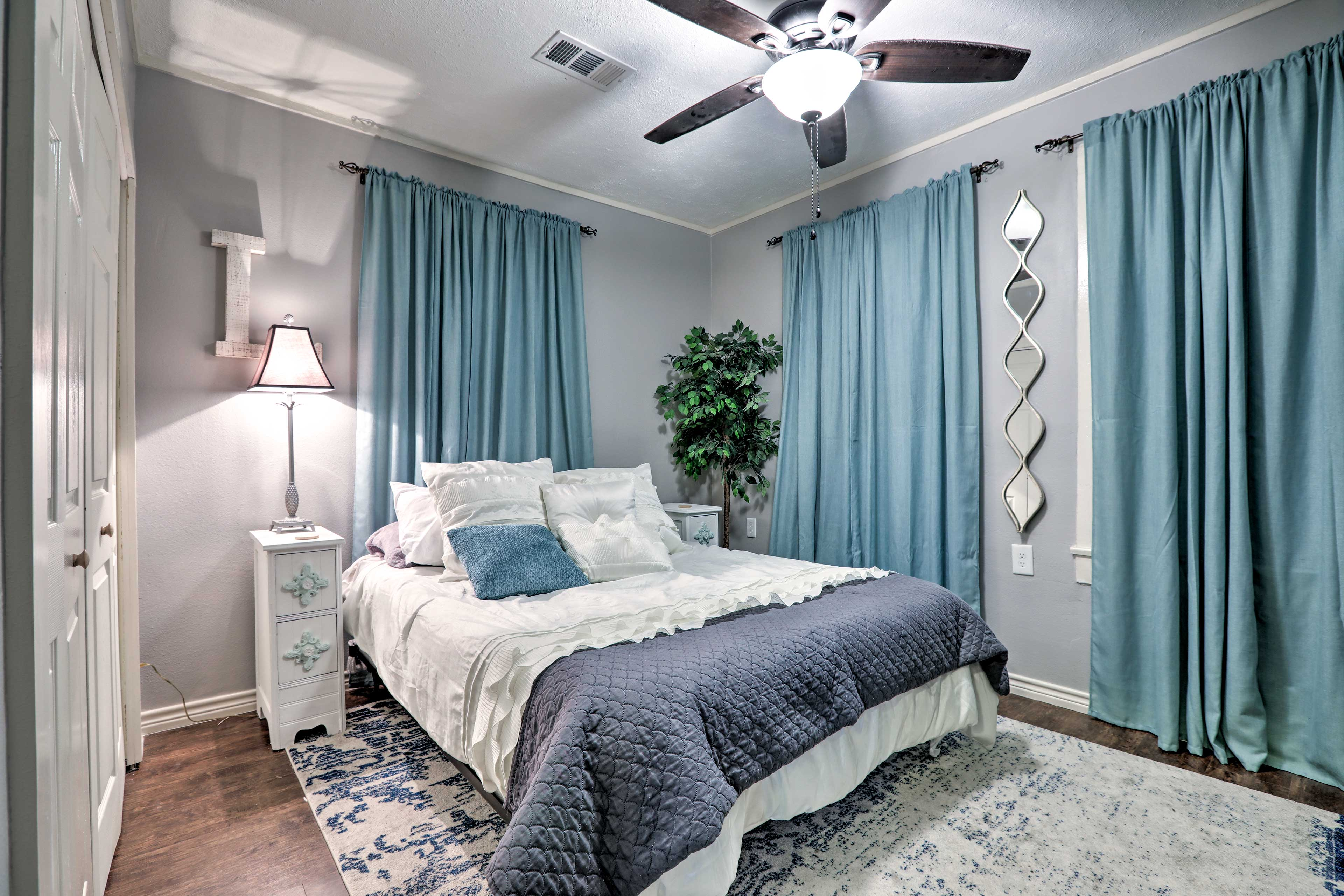 Heads of the household will sleep peacefully in this lovely master bedroom.