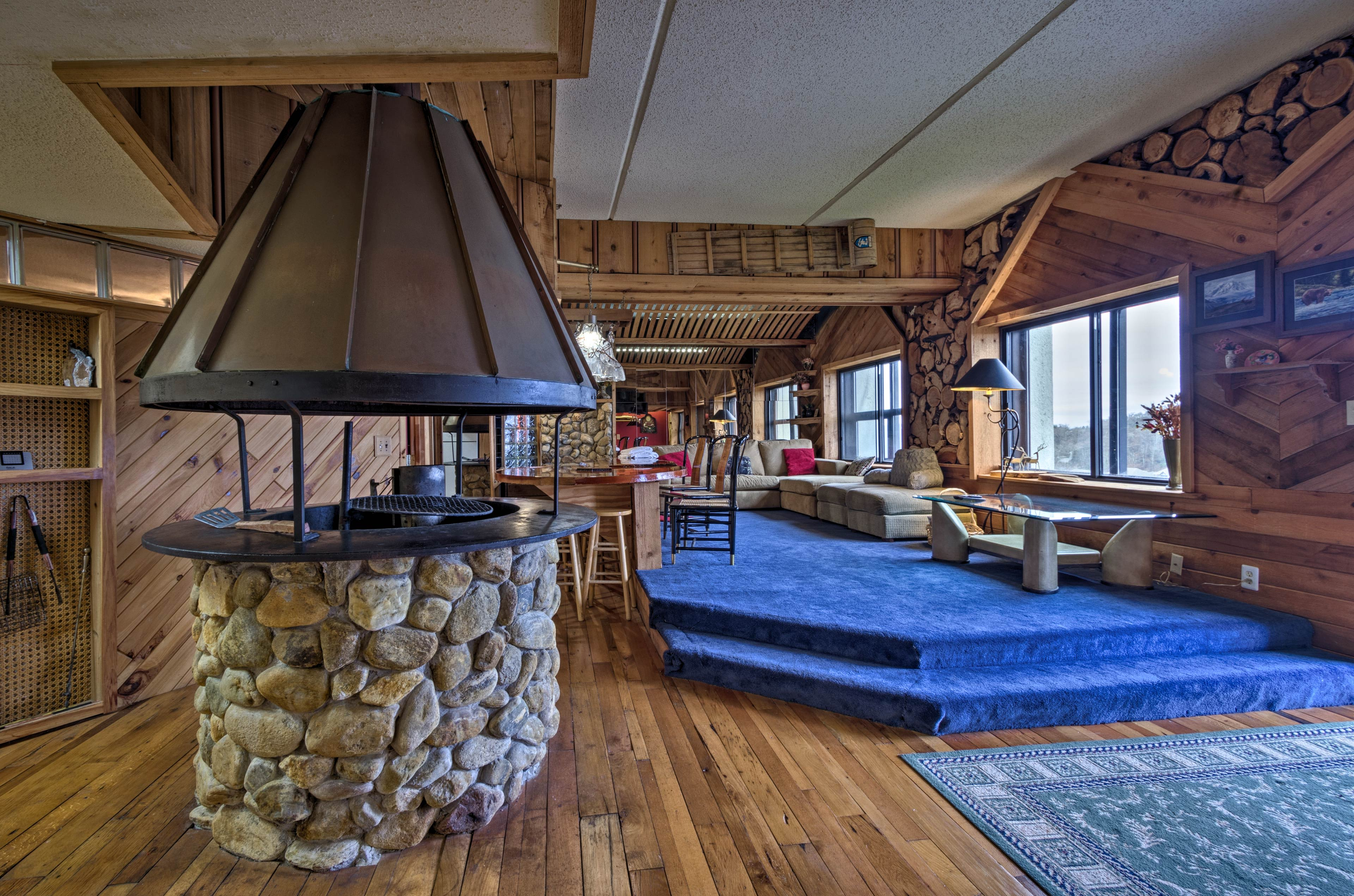 Natural wood walls and flooring bring a rustic feel to the cozy space.