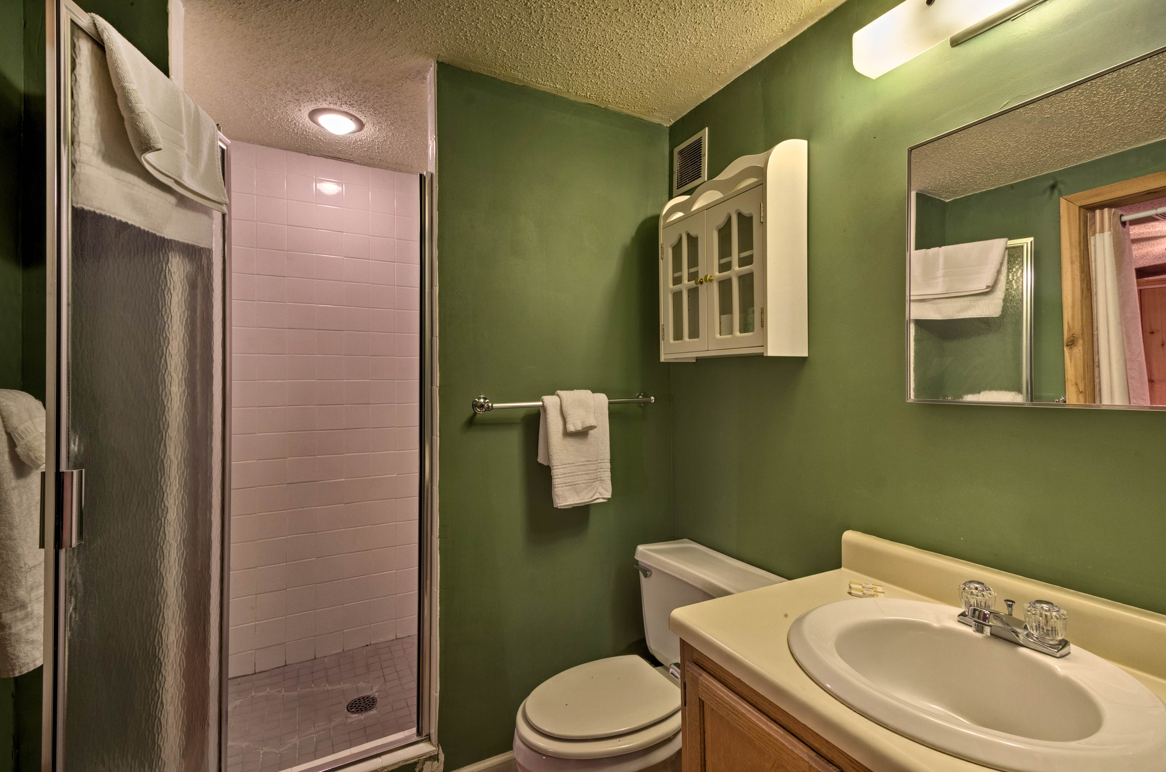 Both bathrooms come stocked with fresh towels.